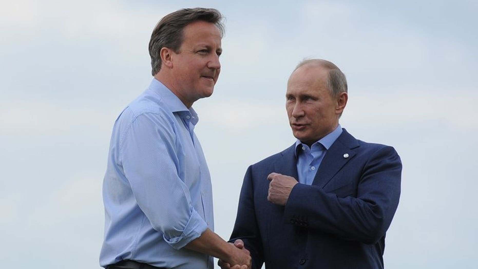 British Prime Minister David Cameron (L) greets Russia's President Vladimir Putin during the official arrrivals for the start of the G8 Summit at the Lough Erne resort near Enniskillen in Northern Ireland on June 17, 2013. UK officials said Russia risks isolation from the West if it does not sign up to action in Syria.
