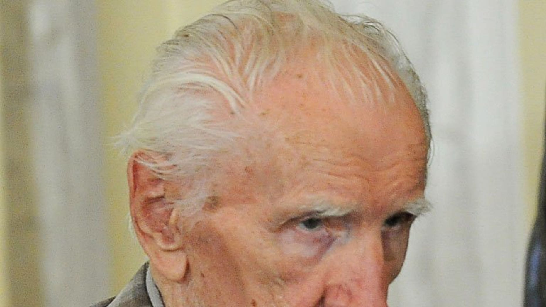 File picture shows top Nazi war crimes suspect Laszlo Csatari, aka Laszlo Csizsik-Csatari, leaving a courthouse in Budapest on July 18, 2012. Csatari, accused of overseeing thousands of Jewish deportations during World War II, was charged with war crimes on Tuesday in Hungary, prosecutors said.