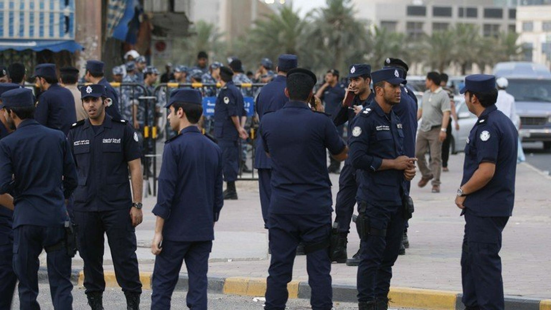 "Kuwaiti police stand guard in Kuwait City on May 27, 2011. Authorities in Kuwait hanged a 33-year-old Egyptian man dubbed a ""monster"" for the abduction and rape of 17 children under the age of 10,"