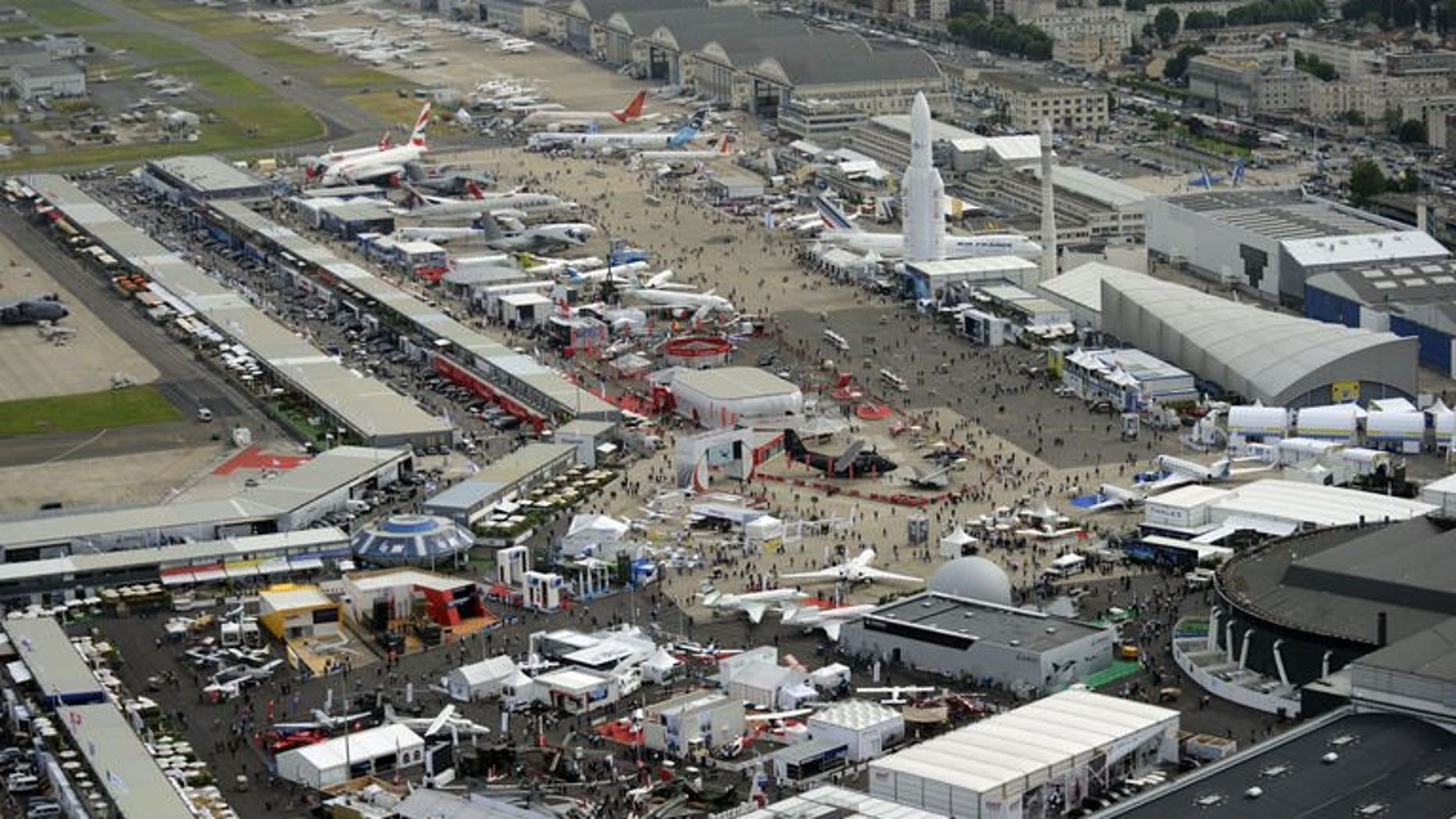Aerial view of Le Bourget airport, near Paris taken on June 18, 2013 during the 50th International Paris Air show. Canadian plane maker Bombardier announced dozens of orders at the Paris Air Show on Tuesday in two separate deals worth about $1.3 billion (971 million euros) at catalogue prices.