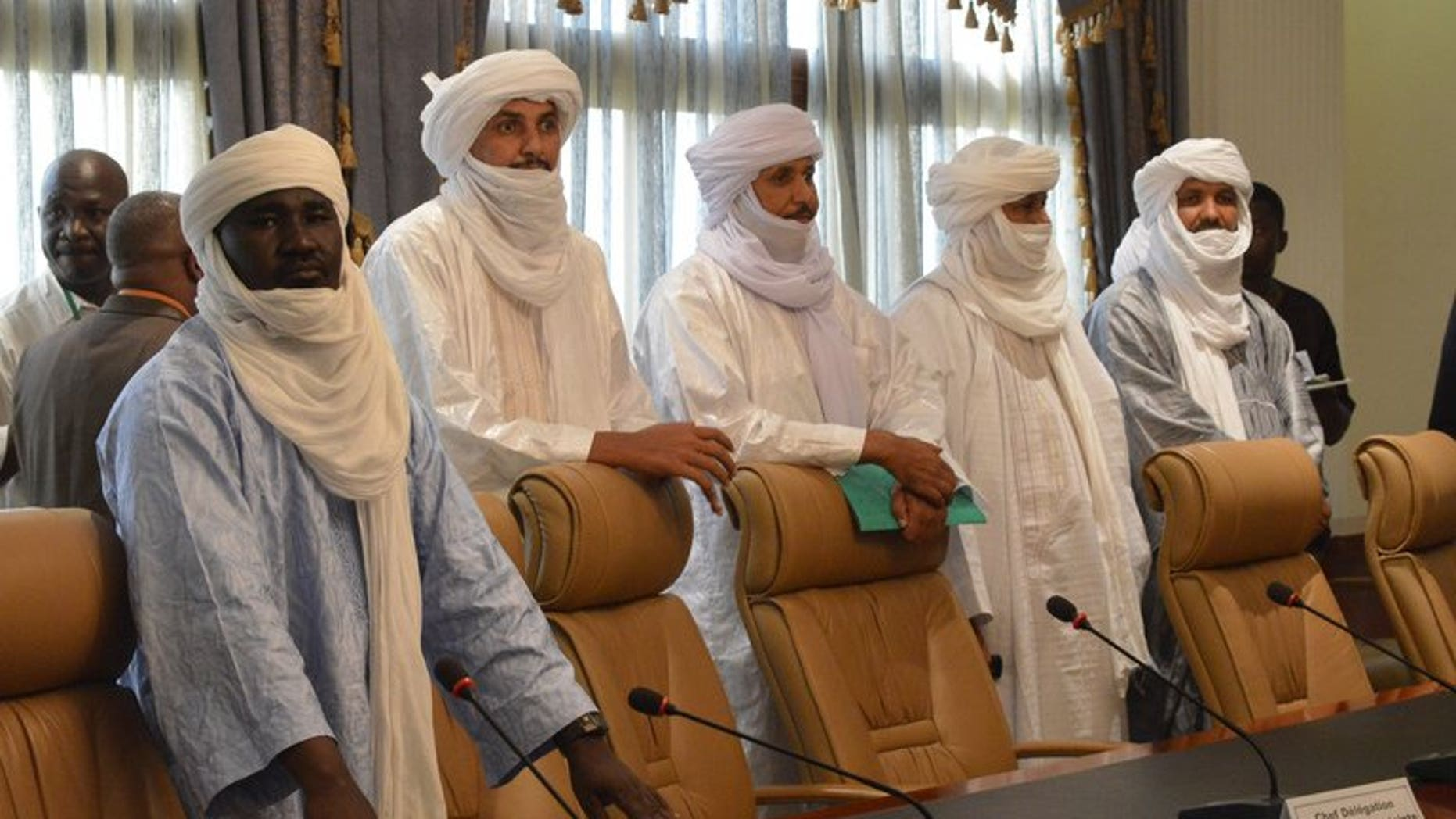 Tuareg delegates arrive to meet a Mali government delegation in Ougadougou, Burkina Faso, last week. Bamako will sign a deal with Tuareg rebels on Tuesday that is expected to pave the way for nationwide polls next month, a Mali government envoy told AFP.