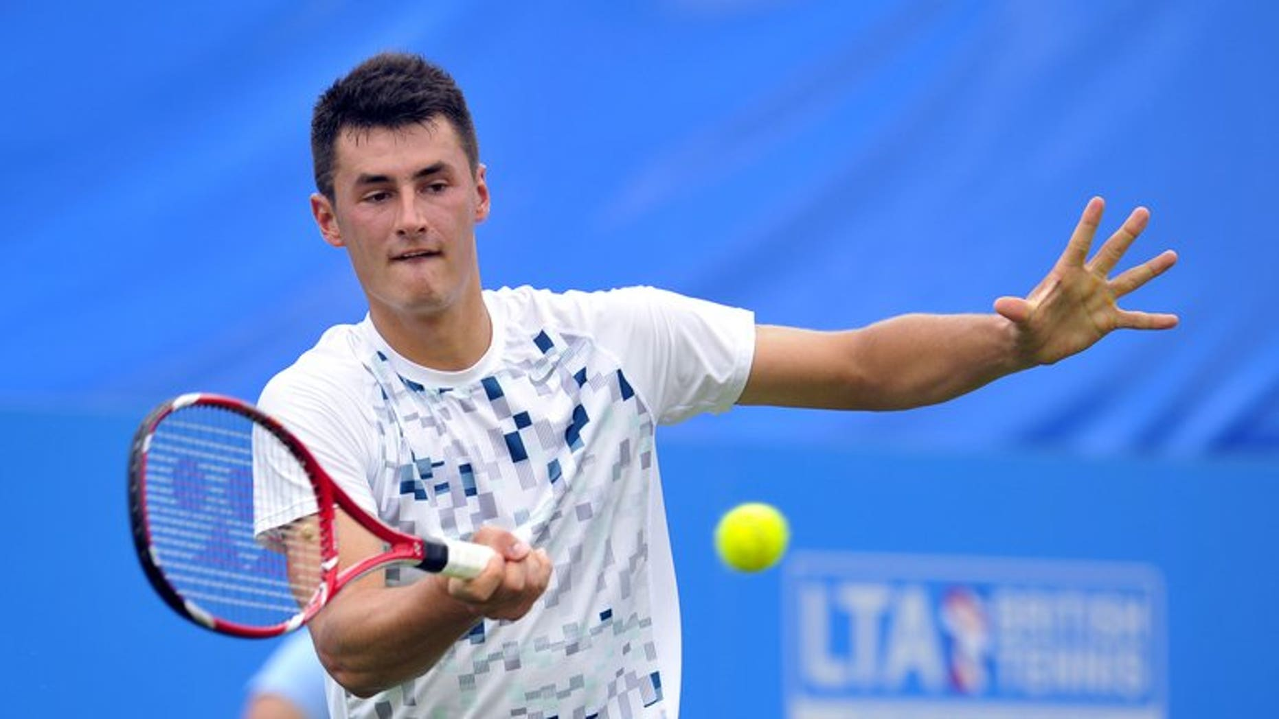 Australia???s Bernard Tomic plays against Britain???s James Ward during the AEGON International tennis tournament in Eastbourne on June 18, 2013. Tomic has recharged his form on grass, shaking off last week's hamstring concern to post a 6-3, 6-4 first round win over Ward at the ATP-WTA Eastbourne International.