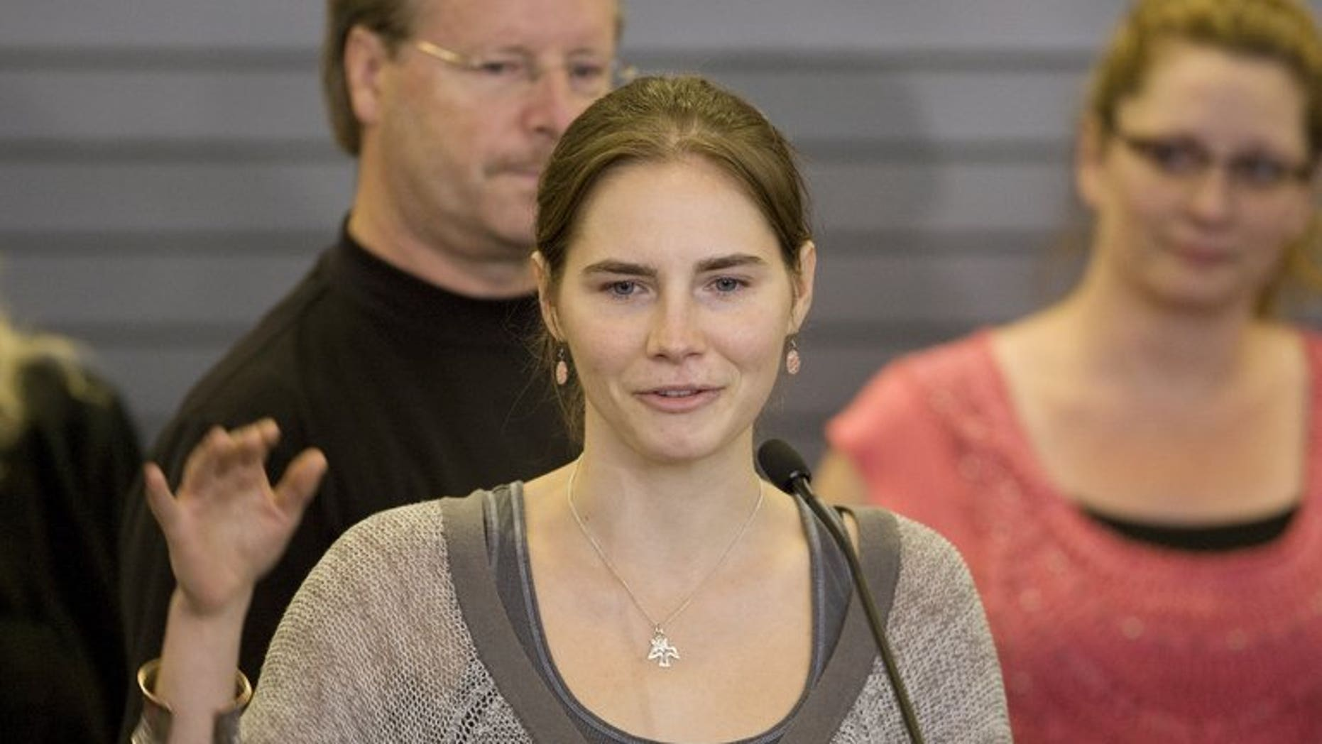 Amanda Knox makes her first appearance after arriving in Seattle following her release from prison in Italy on October 4, 2011. A ruling acquitting US student Knox over the brutal murder of her British housemate in 2007 had numerous contradictory and incoherent elements, Italy's highest appeals court said Tuesday, explaining its decision to order a retrial.