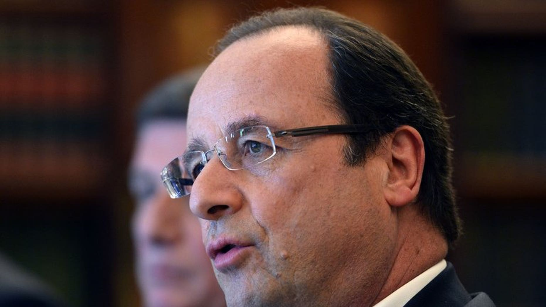"""French President Francois Hollande speaks during a bilateral meeting on the sidelines of the G8 summit near Enniskillen, Northern Ireland on June 18, 2013. Hollande said Tuesday that Iranian president-elect Hassan Rowhani would be welcome at Syria peace talks """"if he can be useful""""."""