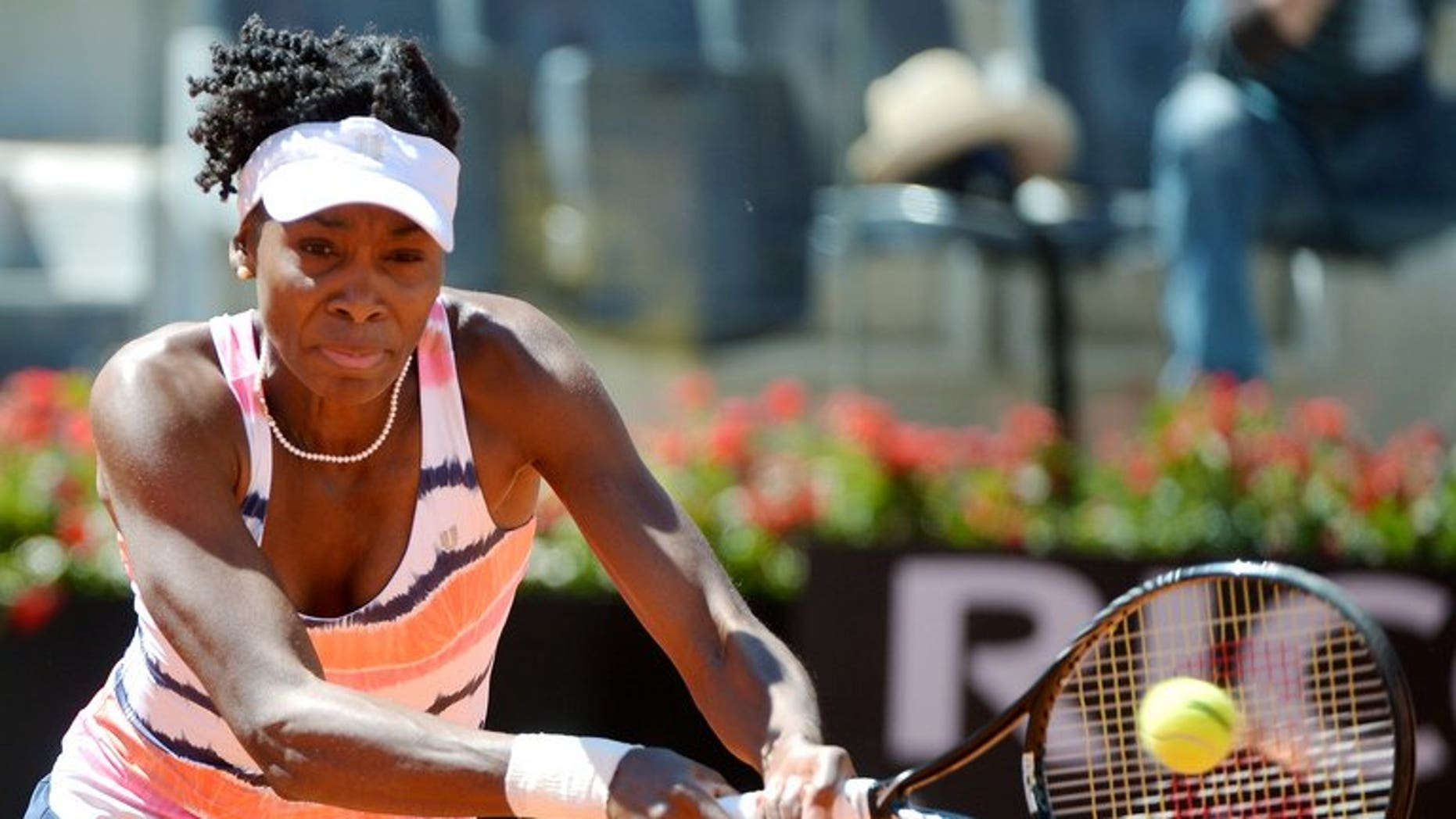 Venus Williams of the United States returns a forehand to Australian Laura Robson during the WTA Italian Open in Rome on May 13, 2013. Venus has pulled out of this year's Wimbledon tournament because of an ongoing lower back injury.