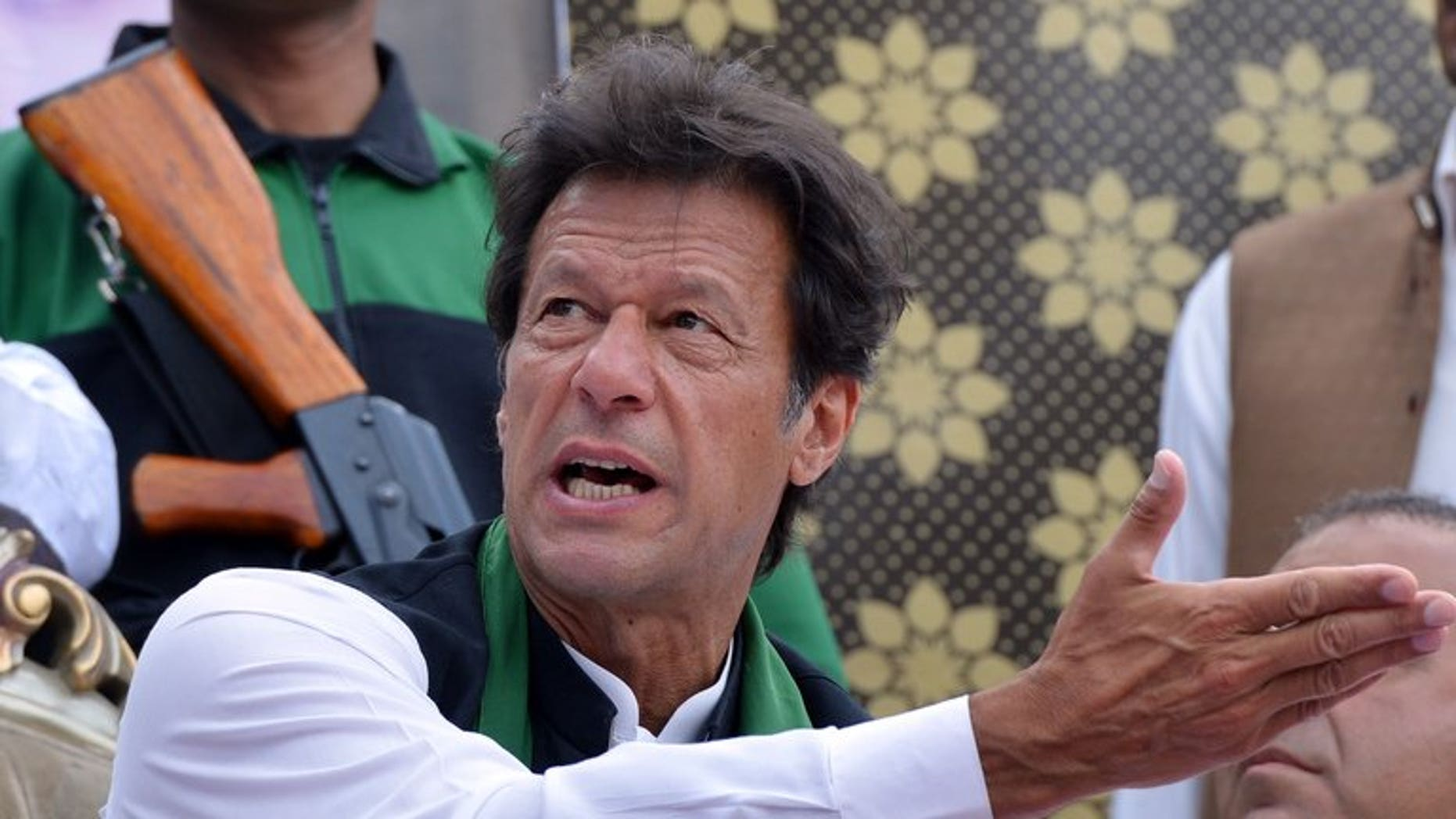Cricket legend and chairman of Pakistan Tehreek-e-Insaaf (PTI) Imran Khan gestures as he attends a general election campaign meeting in Murree on April 29, 2013. Khan urged the government and military leaders to build a strategy to halt US drone attacks in the country's northwest as he was sworn into parliament.