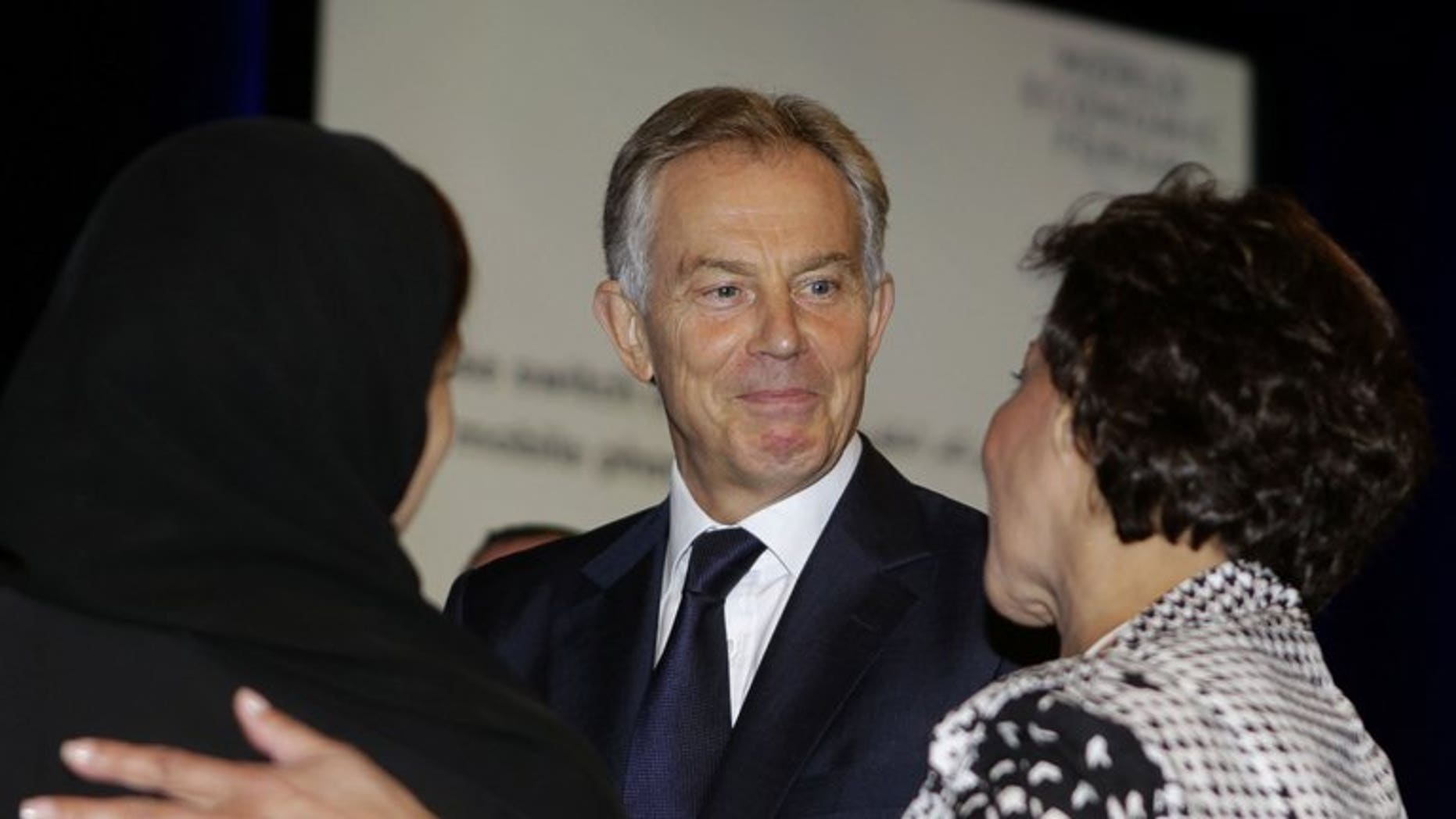 Tony Blair talks to other delegates at a conference in Jordan last month. Time is running out for the Middle East peace process, which must move forward or face total failure, the former British prime minister said on Wednesday.