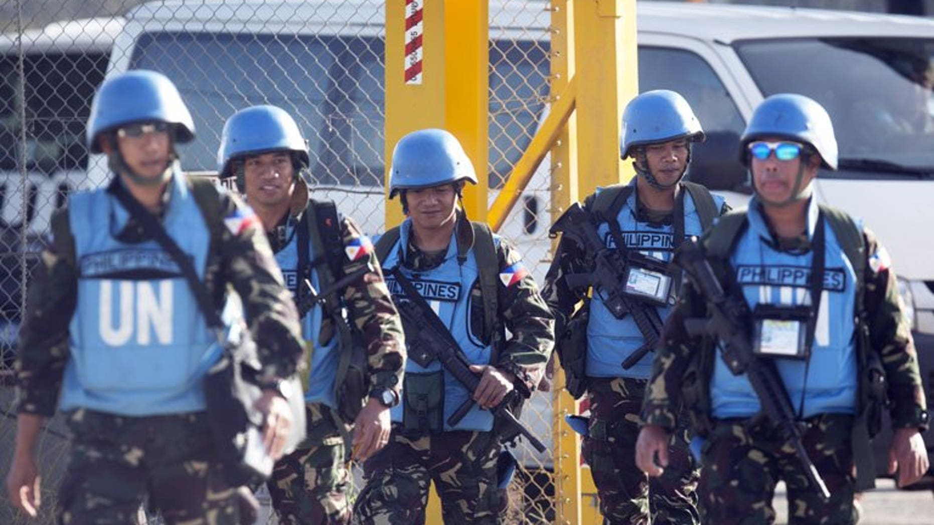 Philippines troops at the Quneitra crossing between Syria and the Israeli annexed Golan Heights last week. The Philippines Wednesday said it would keep its peacekeepers in the Golan Heights until at least August, and may stay longer if the United Nations increased security there.