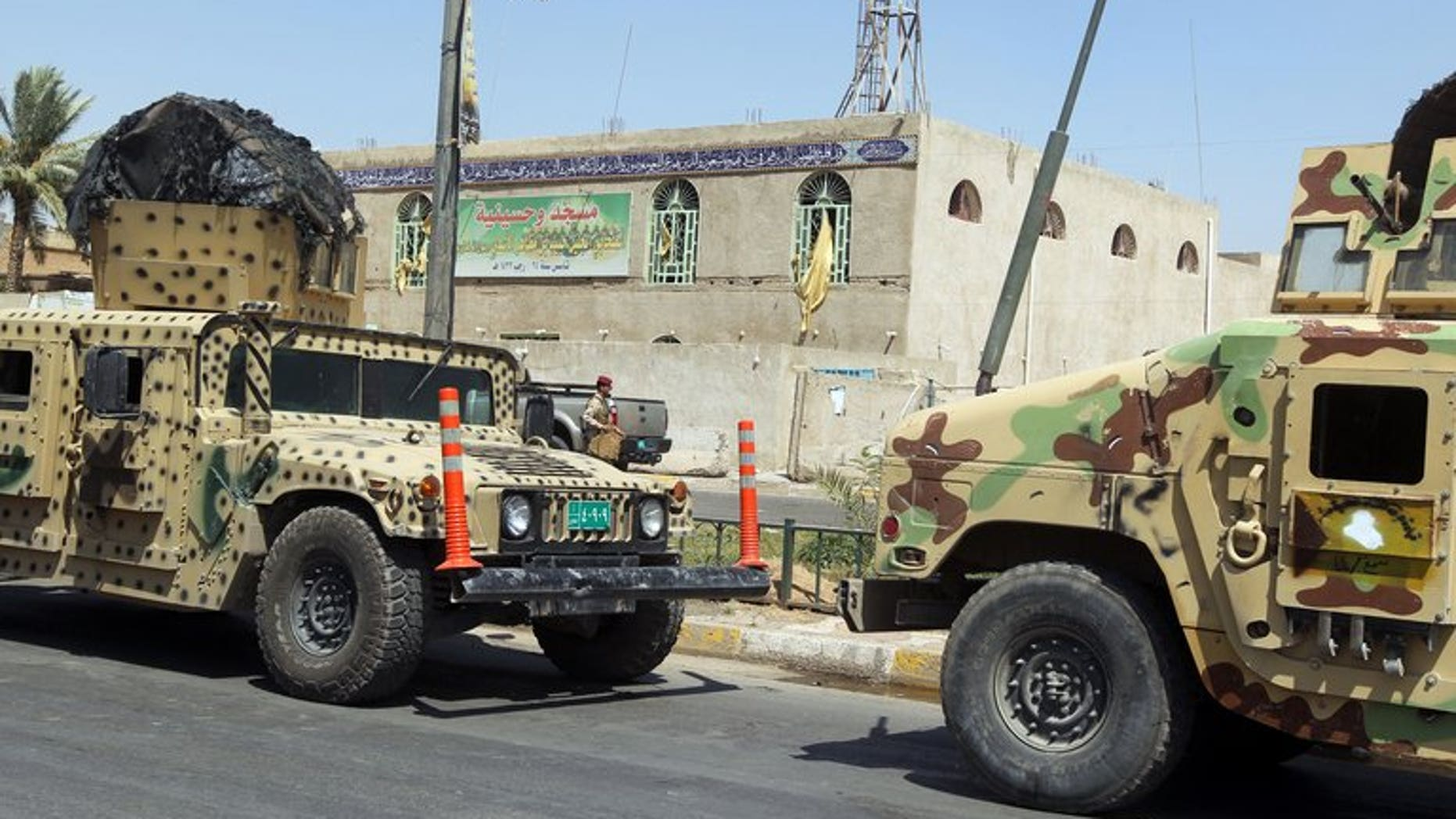 Iraqi military vehicles in front of a Shiite mosque in Baghdad on Tuesday following a suicide bombing. A suicide bomb attack in north Iraq on Wednesday killed the leader of a local political party and four relatives, officials said, on the eve of provincial elections his bloc was to participate in.