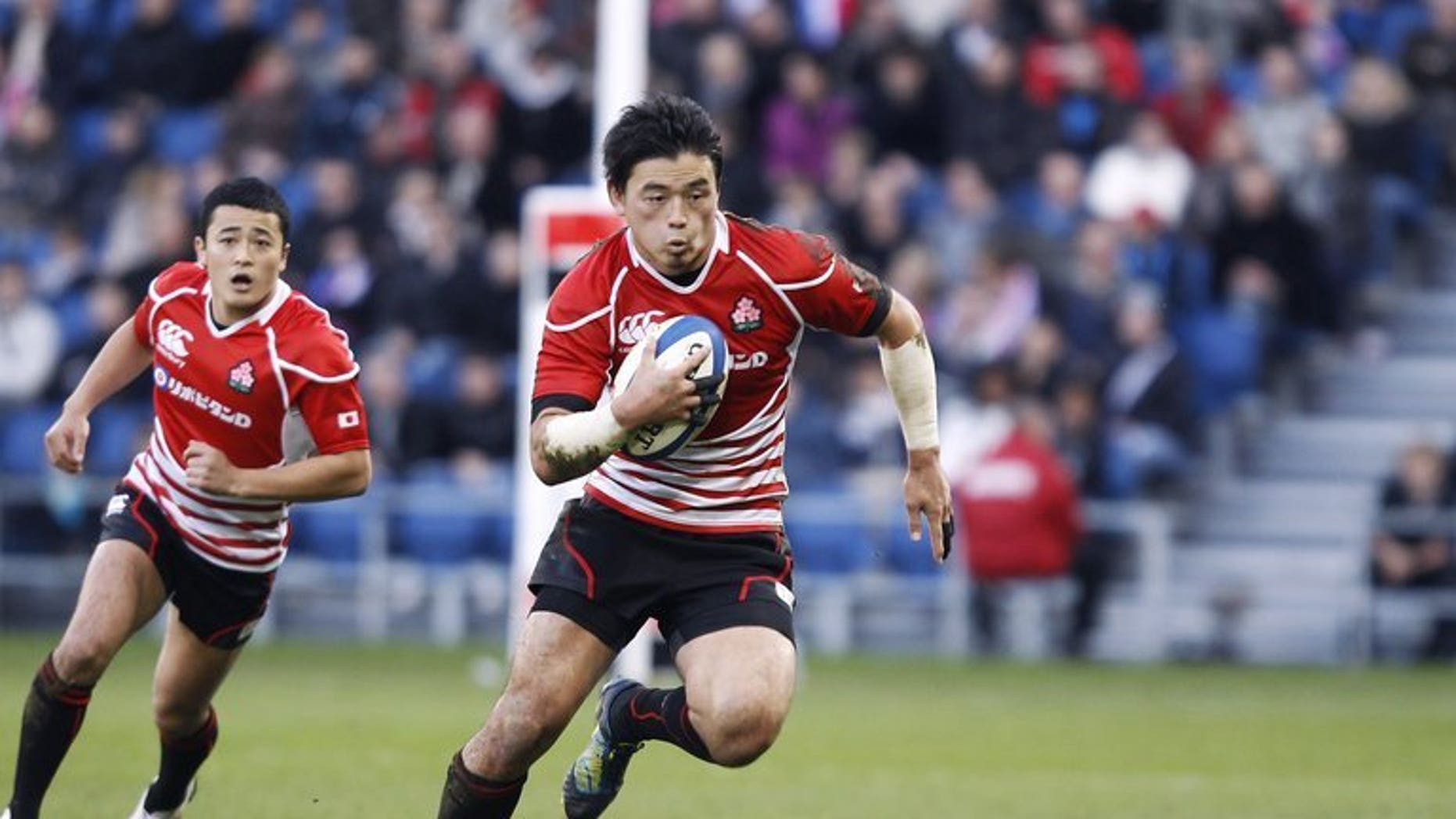 Ayumu Goromaru (centre) plays for Japan against the Barbarians in Le Havre, November 25, 2012. The full back scored all the points to lead Asian champions Japan to a 16-13 victory over Canada in the Pacific Nations Cup rugby tournament in Nagoya on Wednesday.