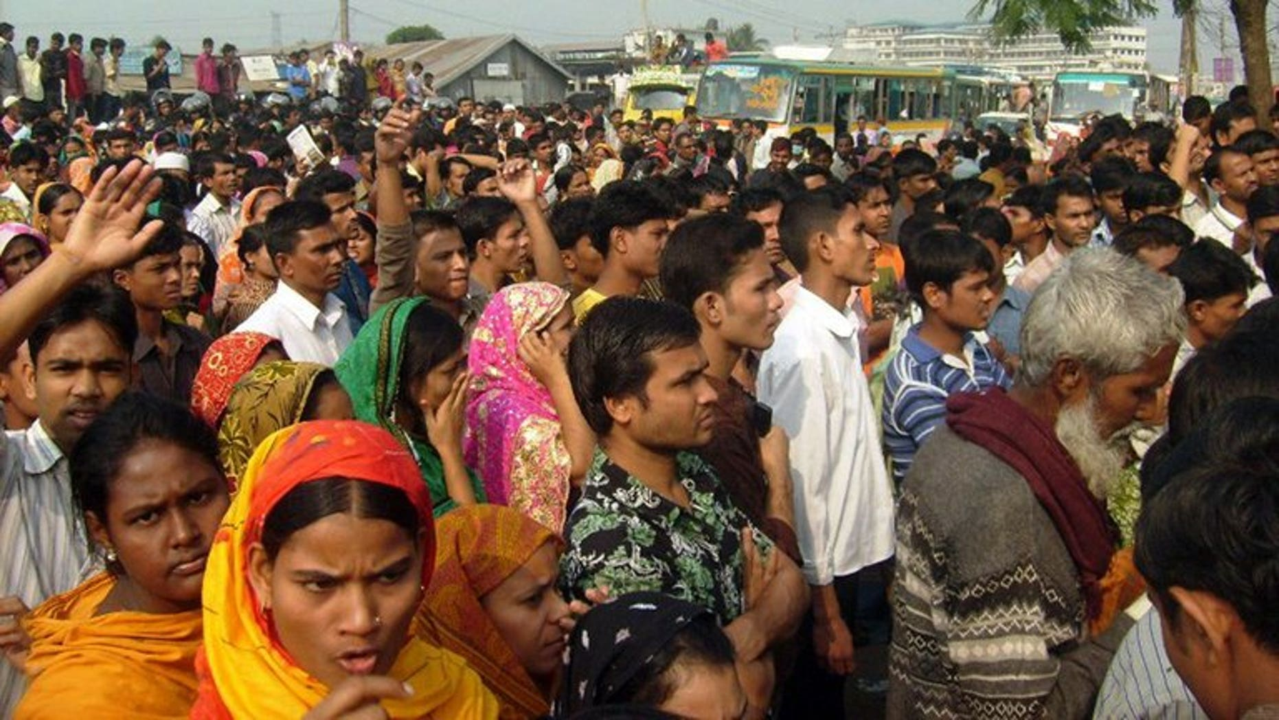 In a file picture taken on December 13, 2010 Bangladeshi garment workers block the road in Gazipur some 35 kms north of Dhaka. Owners of a Bangladesh garment factory were forced to offer prayers and distribute food to the poor on Wednesday in a bid to drive out what workers believed was a ghost at the plant, police said.