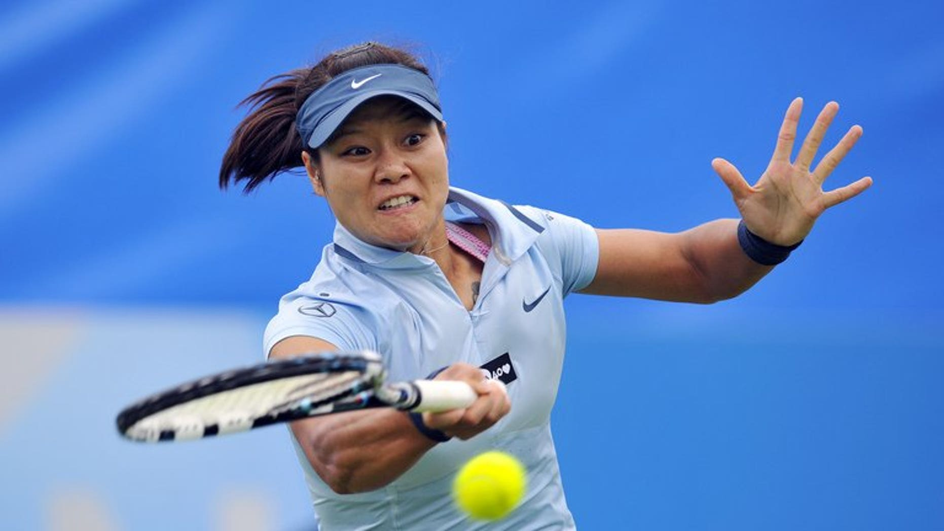 Li Na hits a return against Alize Cornet in Eastbourne, southern England on Tuesday. Li reached the quarter-finals on Wednesday without hitting a ball after scheduled opponent Mario Bartoli pulled out with a virus.