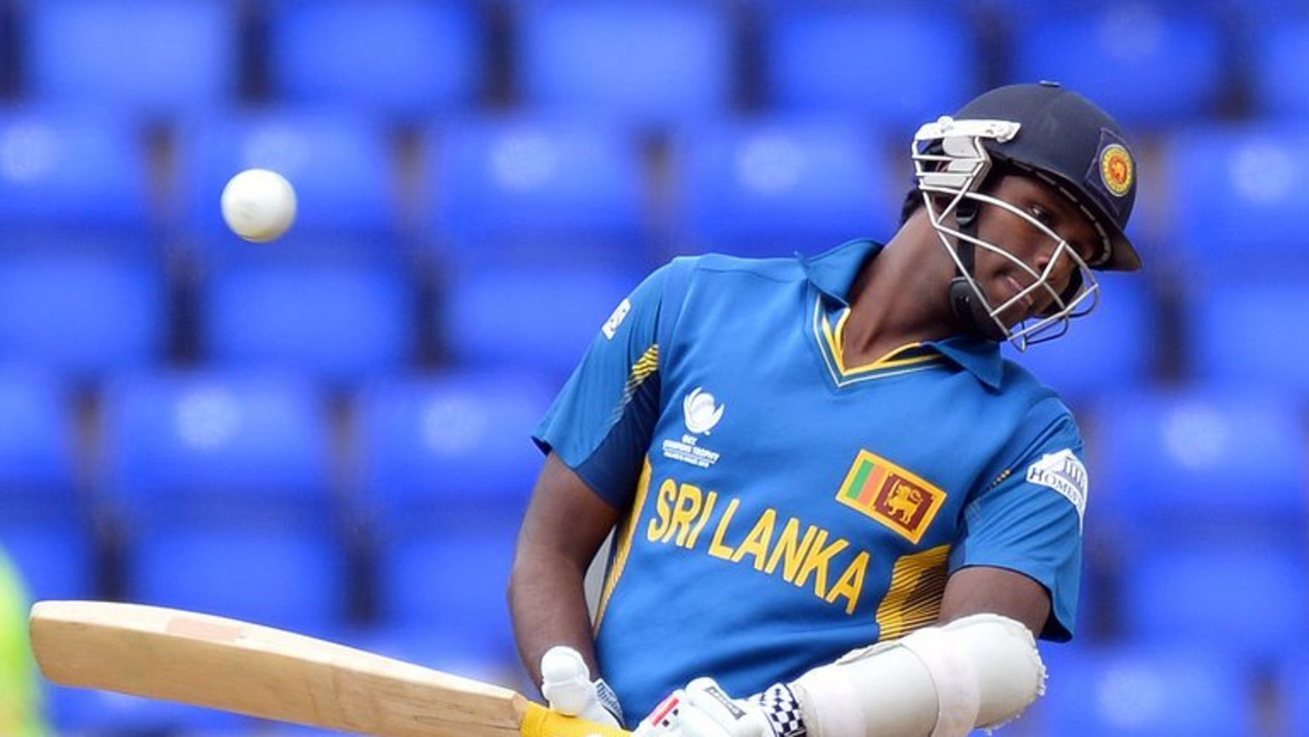 """Sri Lanka's Angelo Mathews avoids a ball during the 2013 ICC Champions Trophy cricket match between Sri Lanka and New Zealand at The Cardiff Wales Stadium in Cardiff, Wales, on June 9, 2013. Mathews on Wednesday vowed that his """"fighting team"""" were prepared to put recent history behind them when they face India in the semi-finals of the Champions Trophy."""