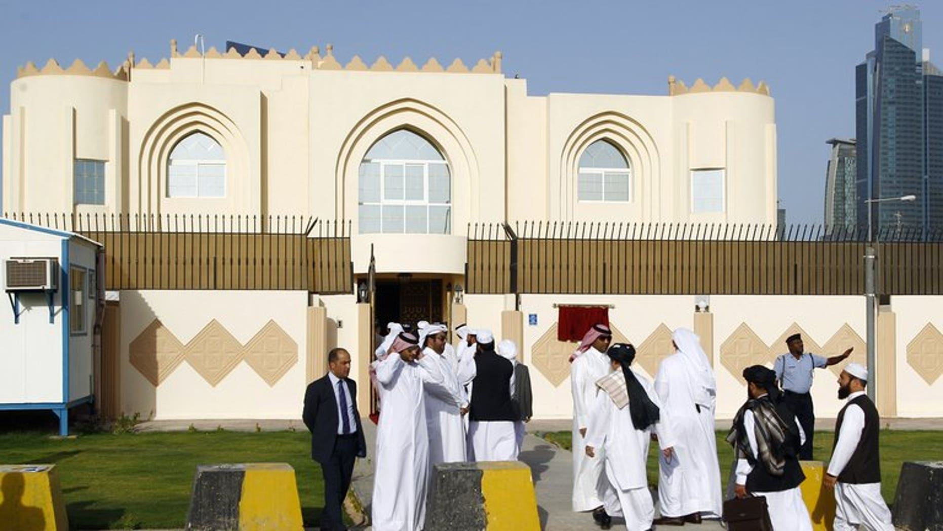 """Guests arrive for the opening ceremony of the new Taliban political office in Doha on June 18, 2013. The Taliban office opened in Doha to facilitate peace talks does not carry the name of the """"Islamic Emirate of Afghanistan,"""" as it appeared earlier, Qatar said on Wednesday."""