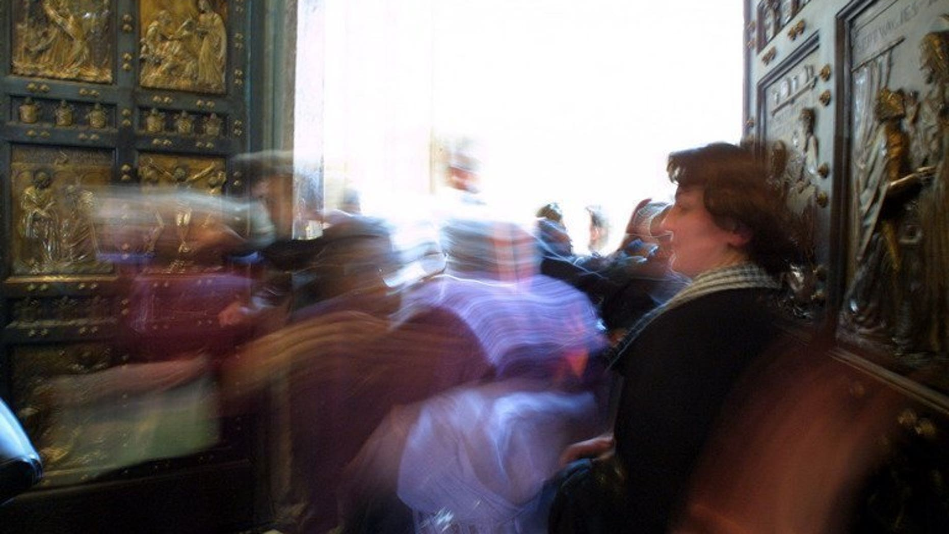 Pilgrims cross the Holy Door in Saint Peter's Basilica, Rome, January 5, 2001. The first Holy door outside of Europe will soon grace one of the oldest Catholic parishes in North America, in the Canadian province of Quebec, a church official told AFP on Wednesday.