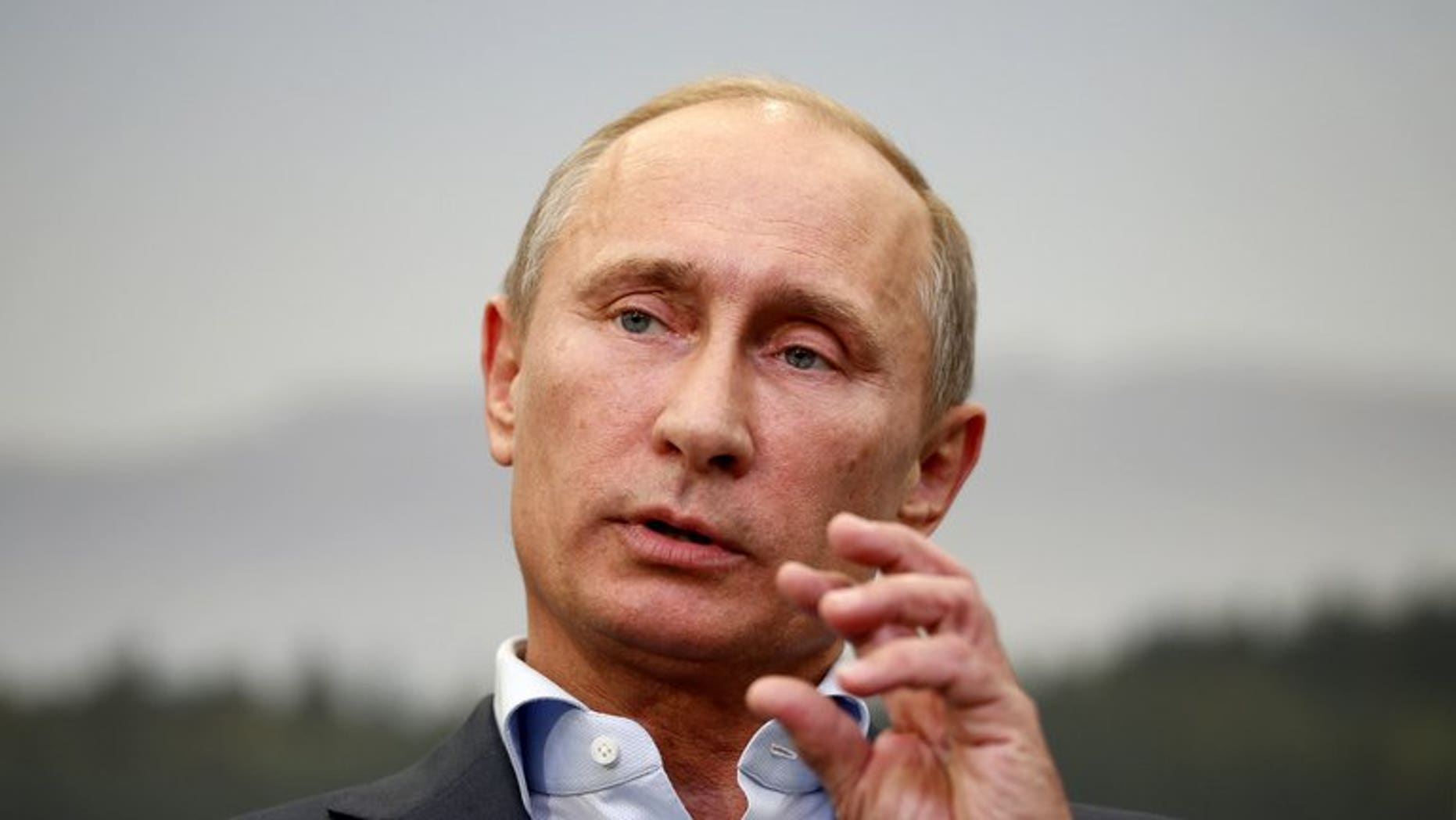Russian President Vladimir Putin speaks during a press conference at the end of the G8 summit in Enniskillen, Northern Ireland, on June 18, 2013. Putin says he has no recollection of allegedly stealing the Super Bowl ring belonging to the National Football League's New England Patriots owner Robert Kraft.
