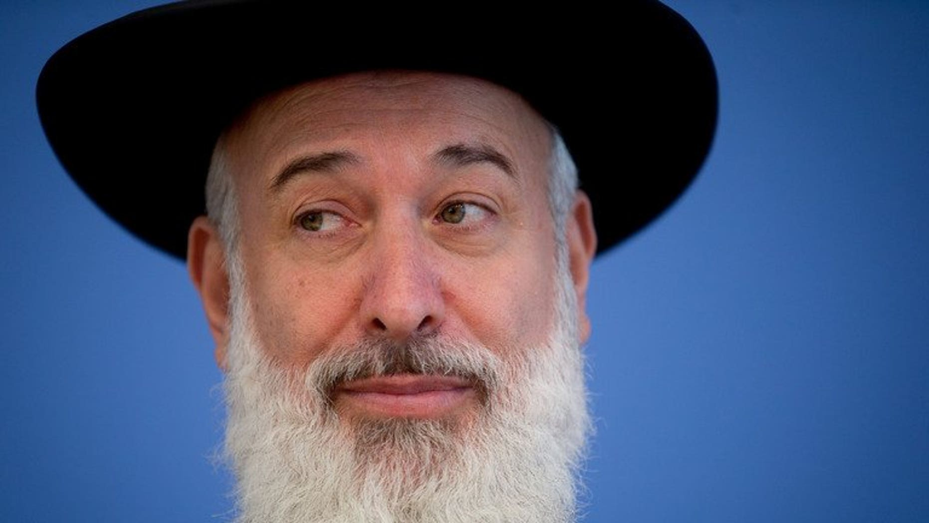Israeli Chief Ashkenazi Rabbi Yona Metzger speaks, seen on August 21, 2012 in Berlin, Germany. Israel's chief Ashkenazi rabbi has been put under house arrest after a marathon grilling by detectives on suspicion of bribery, theft and breach of trust.