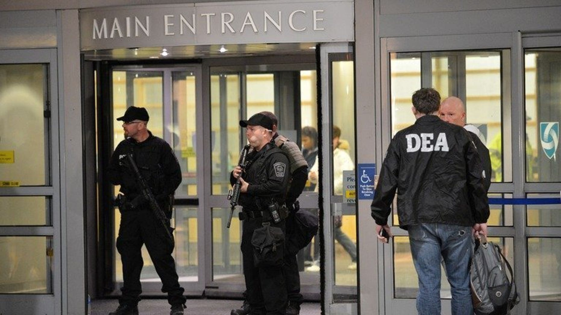 Armed police and Drug Enforcement Agency (DEA) agents in Boston, Massachusetts, April 15, 2013. An agent of the US Drug Enforcement Administration was stabbed to death Friday in Bogota while fighting off an apparent kidnapping attempt, Colombian police and the US embassy said.