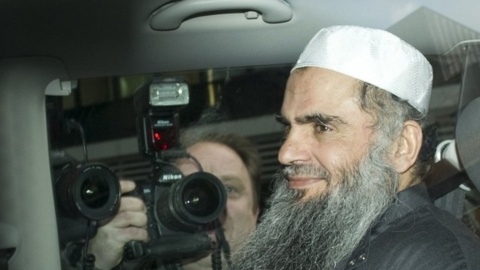 Radical Islamist cleric Abu Qatada sits in a car as he is driven away from a Special Immigration Appeals Hearing at the High Court in London on April 17, 2012. A treaty intended to clear the way to deporting radical cleric Abu Qatada to Jordan has passed into law in Britain.
