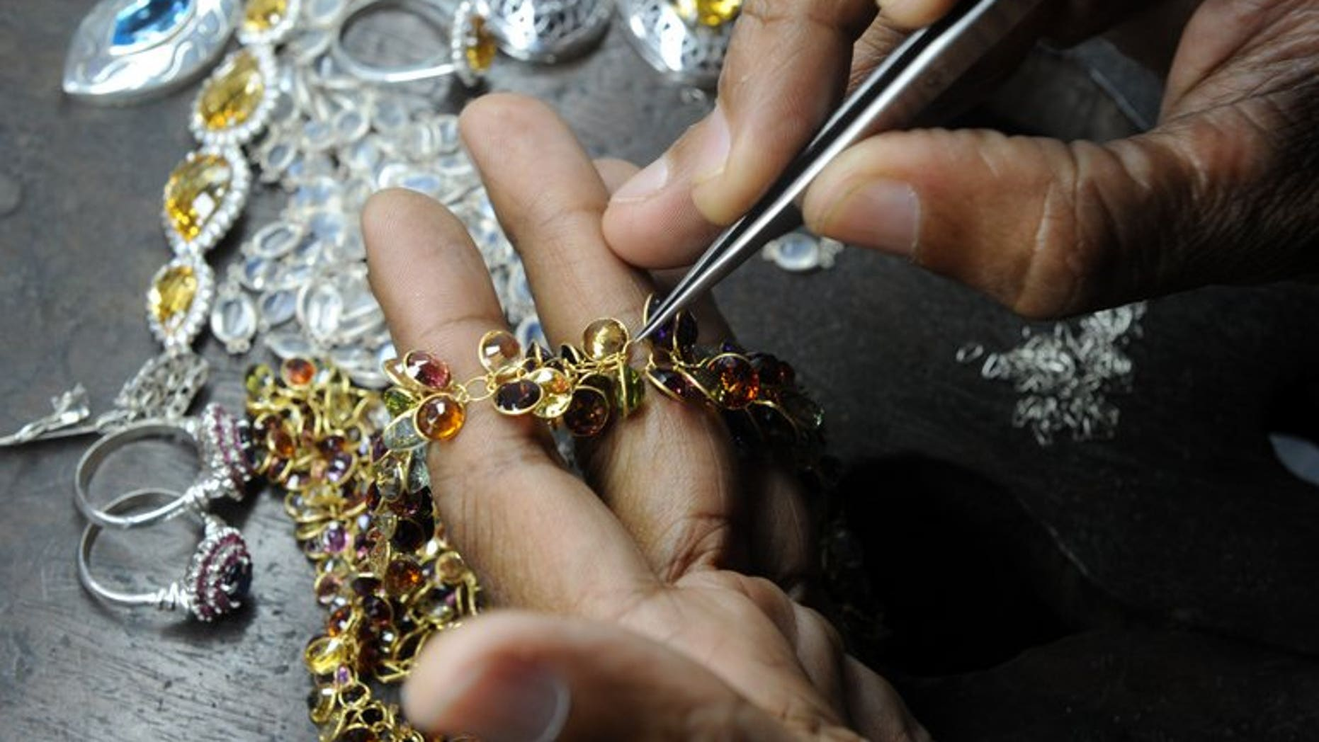 A Sri Lankan worker crafts gold jewellery in the southern city of Galle on January 20, 2011. Sri Lanka announced a 10 percent tax on gold imports Friday in what observers said was a bid to curb smuggling to India as global markets trading in the precious metal reported sharp price drops to 2010 levels.