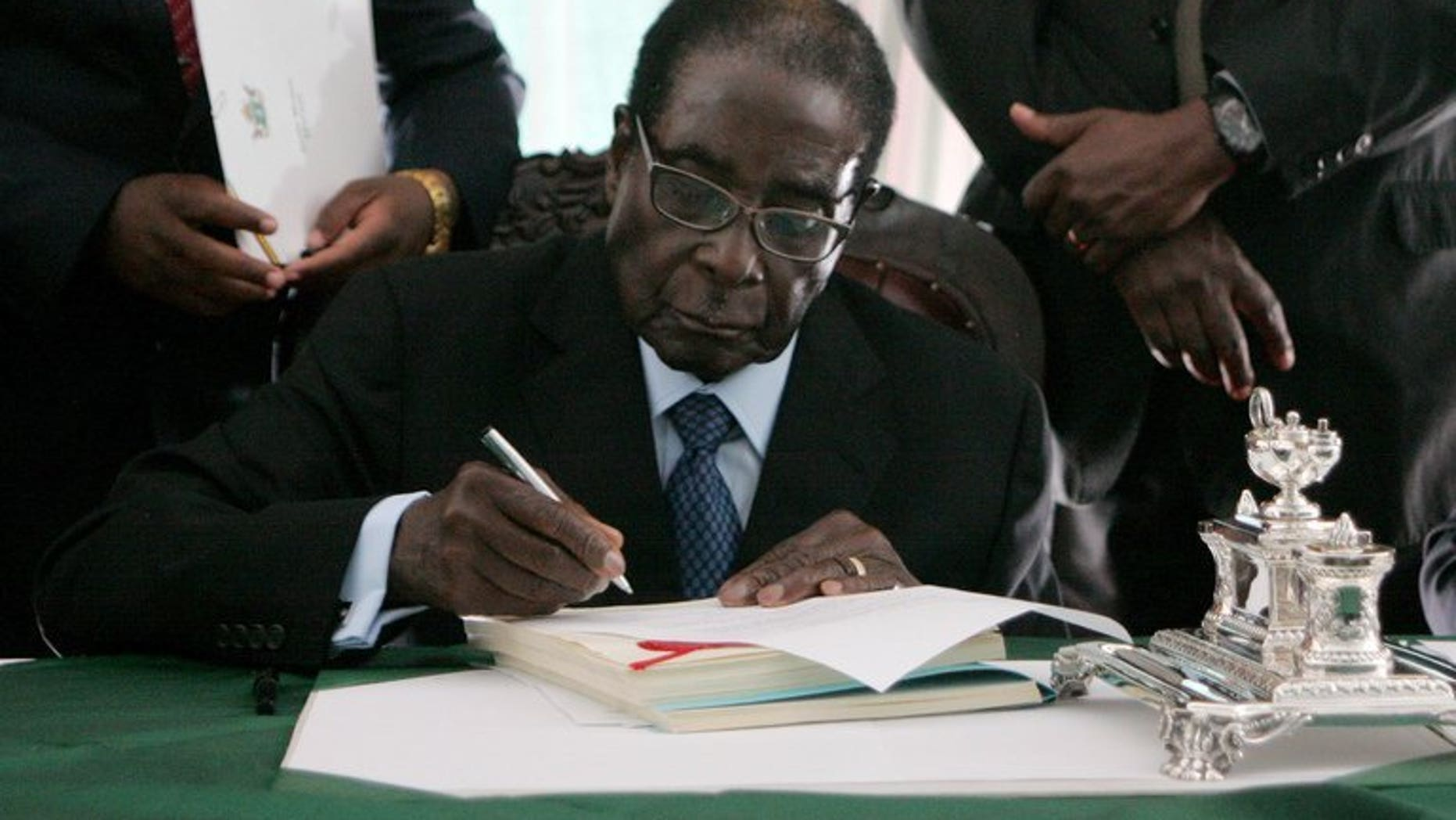 Zimbabwe President Robert Mugabe at the State House in Harare, May 22, 2013. Mugabe appears to have caved in to regional pressure to delay key elections, but analysts warn the veteran ruler could yet forge ahead with the polls without making key reforms.