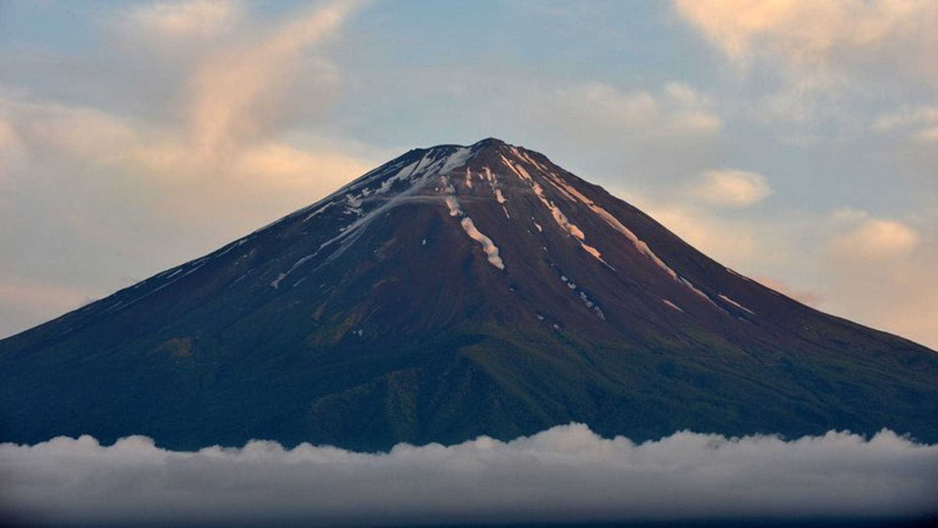 This picture taken on June 16, 2013 shows Mount Fuji, the highest mountain in Japan at 3,776 metres (12,460 feet) in Fujikawaguchiko. UNESCO confirms that Mount Fuji -- known for its perfectly cone-shaped volcano -- has been granted World Heritage status.