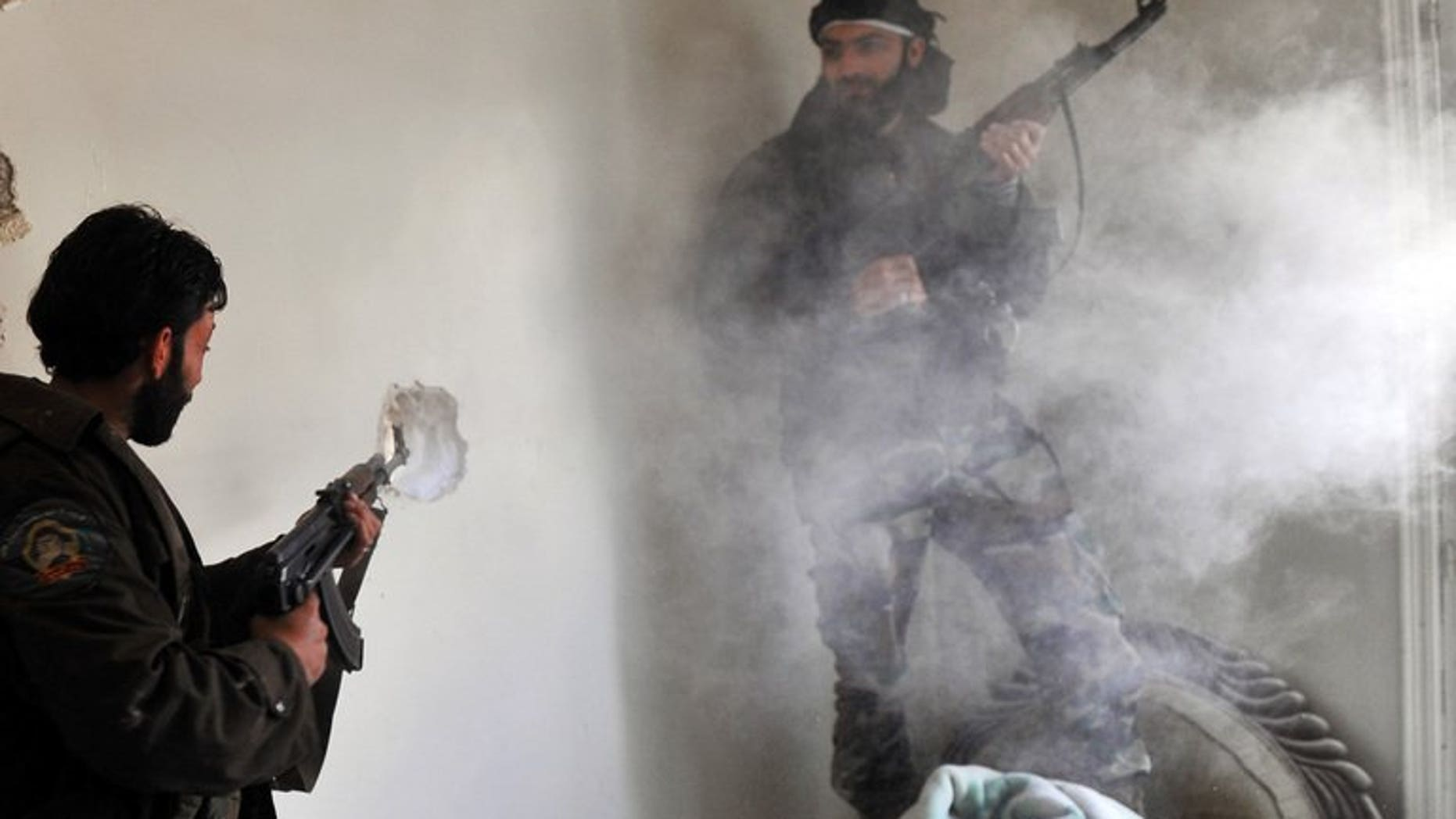 """Syrian rebels clash with pro-regime forces in the Saif al-Dawla district of Aleppo on March 23, 2013. British Foreign Secretary William Hague has said his government had taken """"no decision"""" to provide arms to Syrian rebels, ahead of a """"Friends of Syria"""" meeting expected to discuss military aid."""