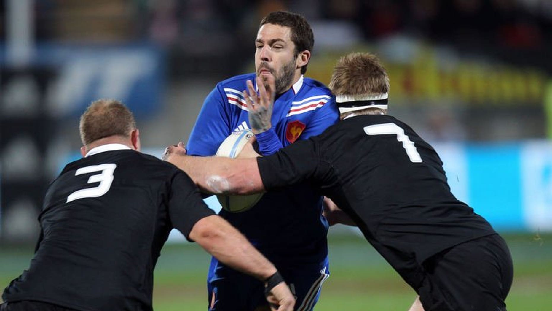 Remi Tales of France (centre) is tackled by Sam Cane (left) and Owen Franks (right) of New Zealand during the third France vs New Zealand rugby union Test match, in New Plymouth on June 21, 2013. The All Blacks beat France 24-9.