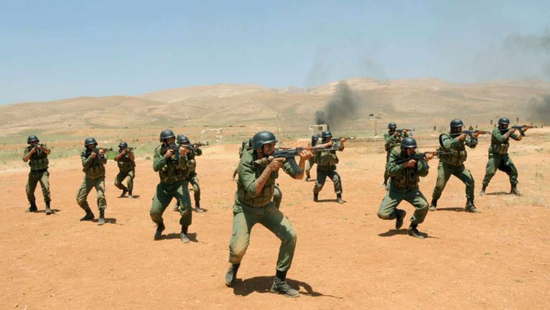 """Syrian government soldiers take part in a training exercise at an undisclosed training camp in Syria on may 22, 2013. US Secretary of State John Kerry says supporters of the Syrian opposition will step up military and other aid in a bid to end an """"imbalance"""" on the ground in President Bashar al-Assad's favour."""