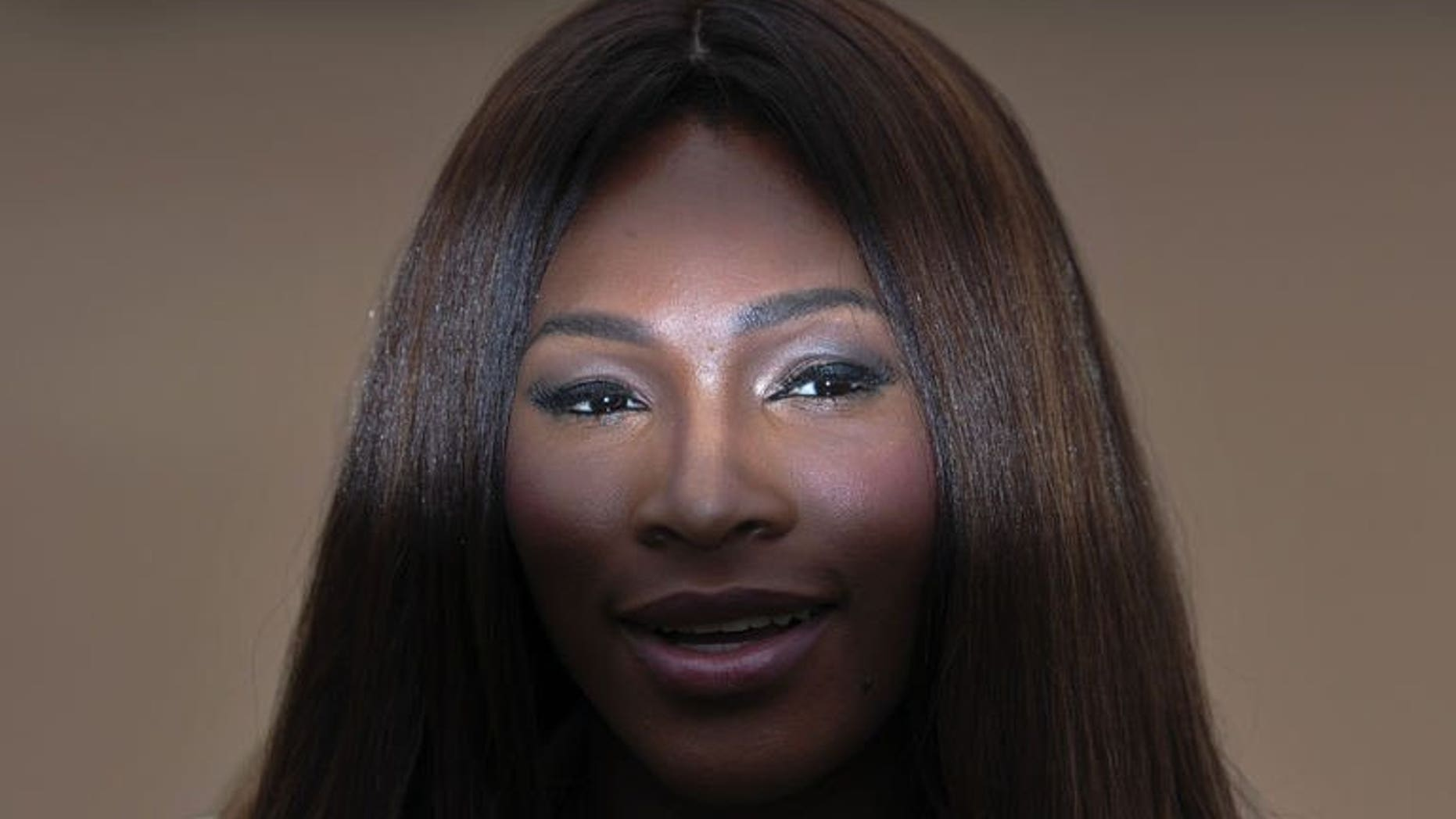 US tennis player Serena Williams poses for photographers as she arrives to attend the Burberry men's fashion show in London on June 18, 2013. Maria Sharapova has blasted Williams for the American's controversial comments over a high-profile rape case and even criticised the Wimbledon champion's private life.