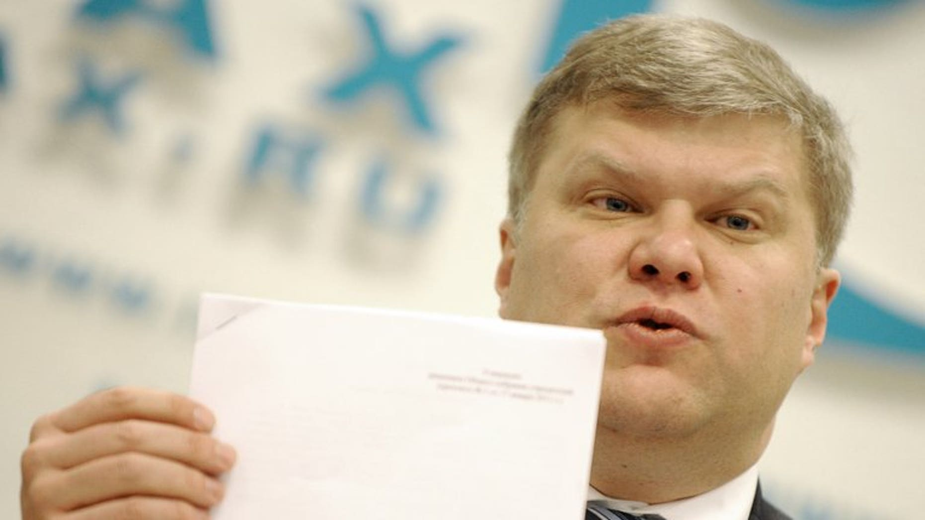The Yabloko opposition party leader Sergei Mitrokhin speaks during a press conference in Moscow, on January 16, 2012. The head of a top Russian rights group and Mitrokhin say they been assaulted by riot police during a night-time raid on the non-profit group in the latest crackdown on activists during Vladimir Putin's new term.