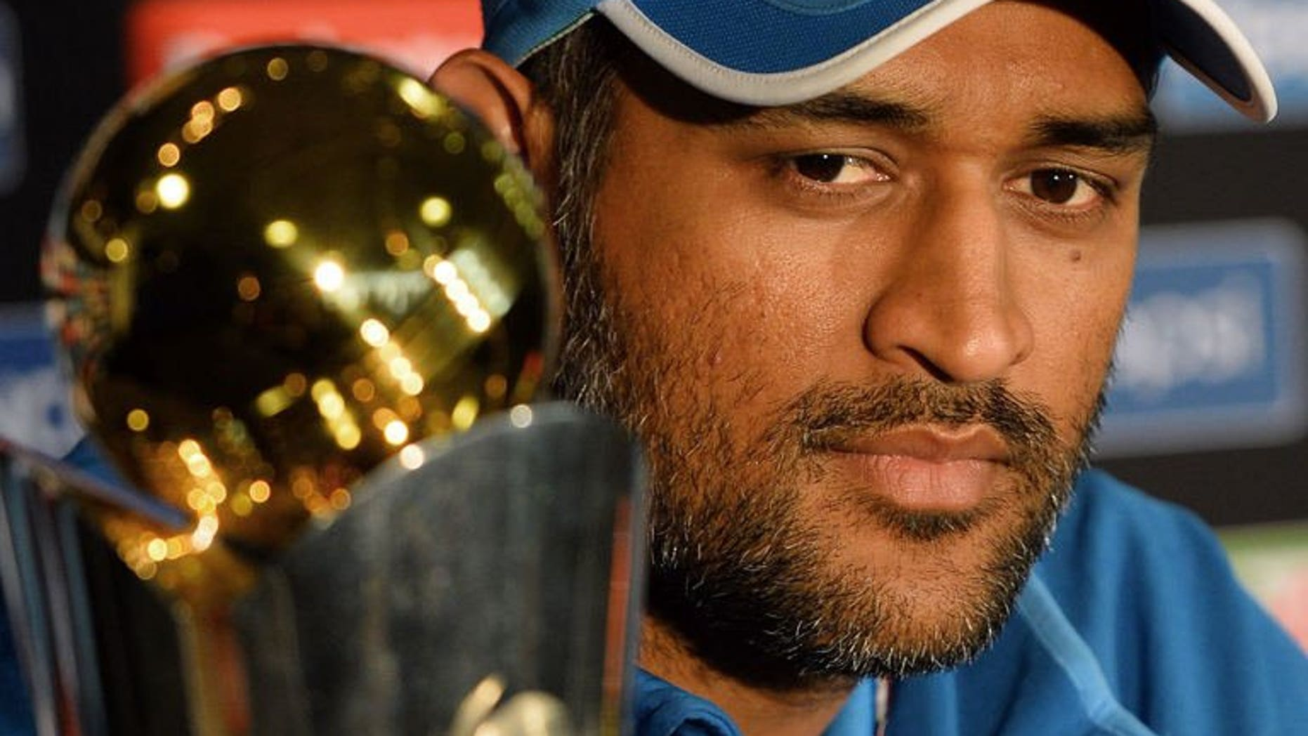 Indian cricket captain Mahendra Singh Dhoni addresses a news conference in Birmingham on June 22, 2013, a day ahead of the Champions Trophy match against England. Dhoni hopes the keen tussle between his young team and hosts England will produce an exciting final.