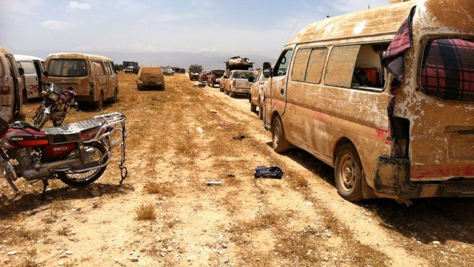Cars left behind by rebels in Dabaa, north of Qusayr, in Syria's central Homs province on June 7, 2013. The CIA and US special operations forces have been training Syrian rebels for months, since long before President Barack Obama announced plans to arm the opposition, the Los Angeles Times reported Friday.