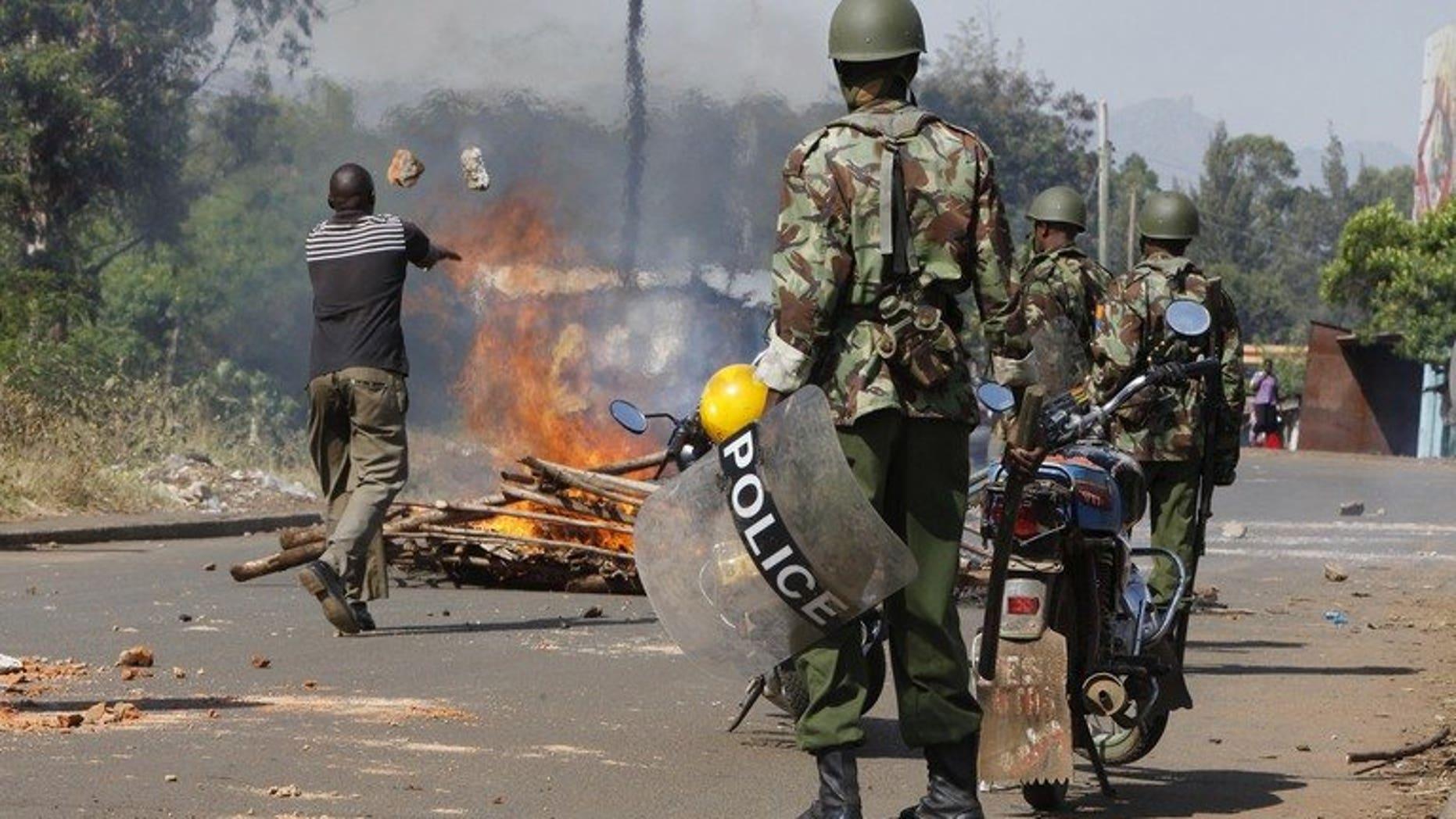 Kenyan police officers are deployed in Kisumu slum on March 9, 2013. Nine people were killed on Friday night in fresh inter-clan violence in northeastern Kenya's border region with war-torn Somalia, police said.