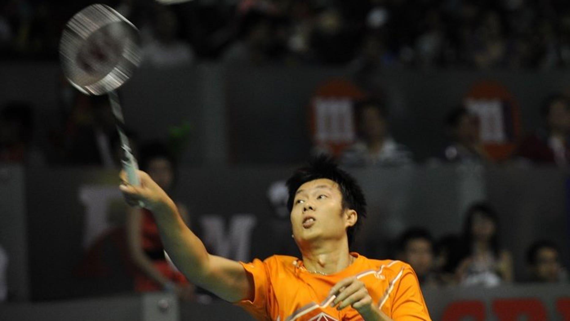 Thailand's Boonsak Ponsana hits a return against Japan's Ueda Takuma during their men's singles semi-final badminton match at the Singapore Open on June 22, 2013. Boonsak won 21-8, 21-15.