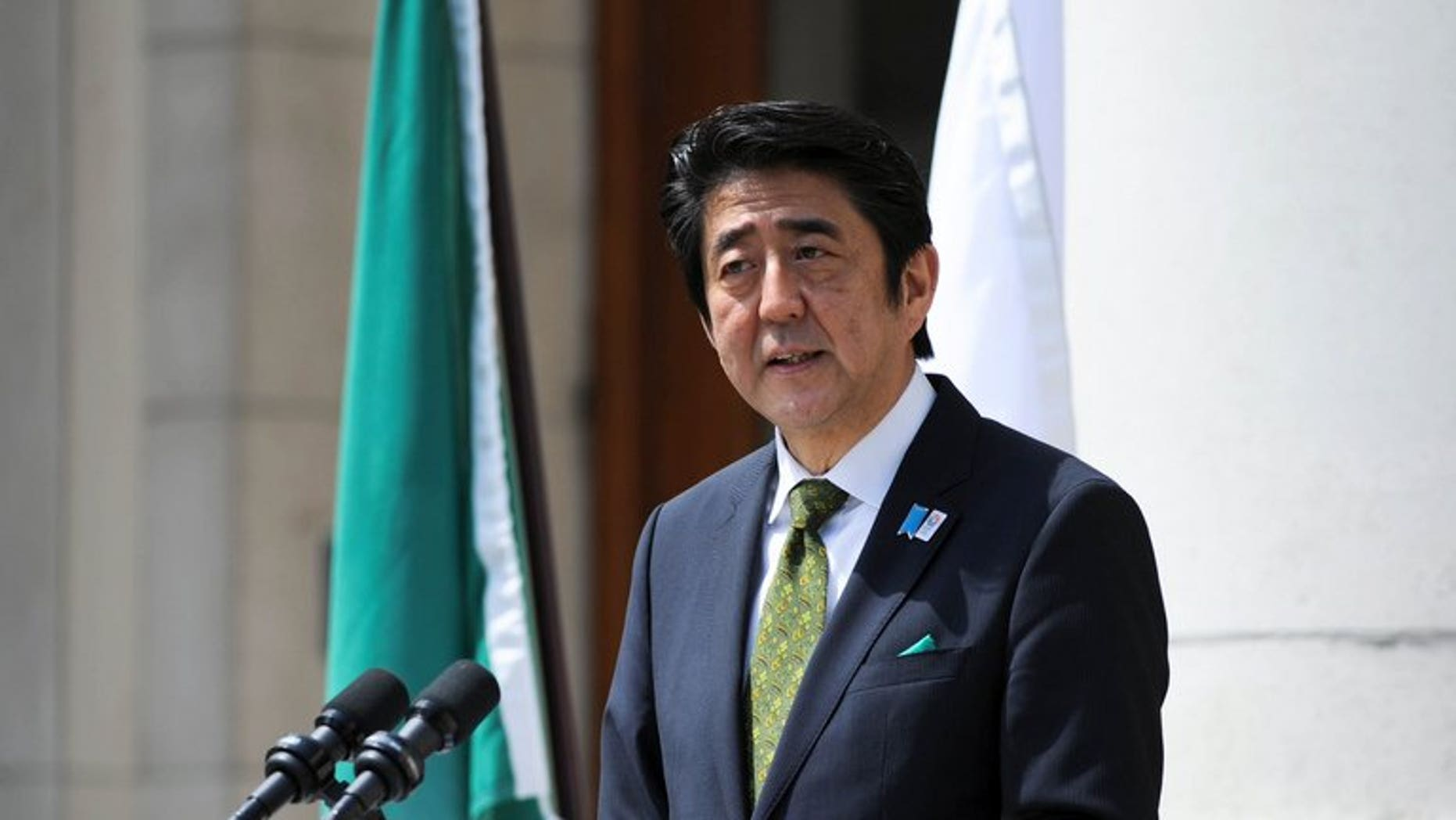 Japanese Prime Minister Shinzo Abe during a press conference in Dublin on June 19, 2013. Tokyo voters headed to the polls in a day seen as a litmus test ahead of national elections.