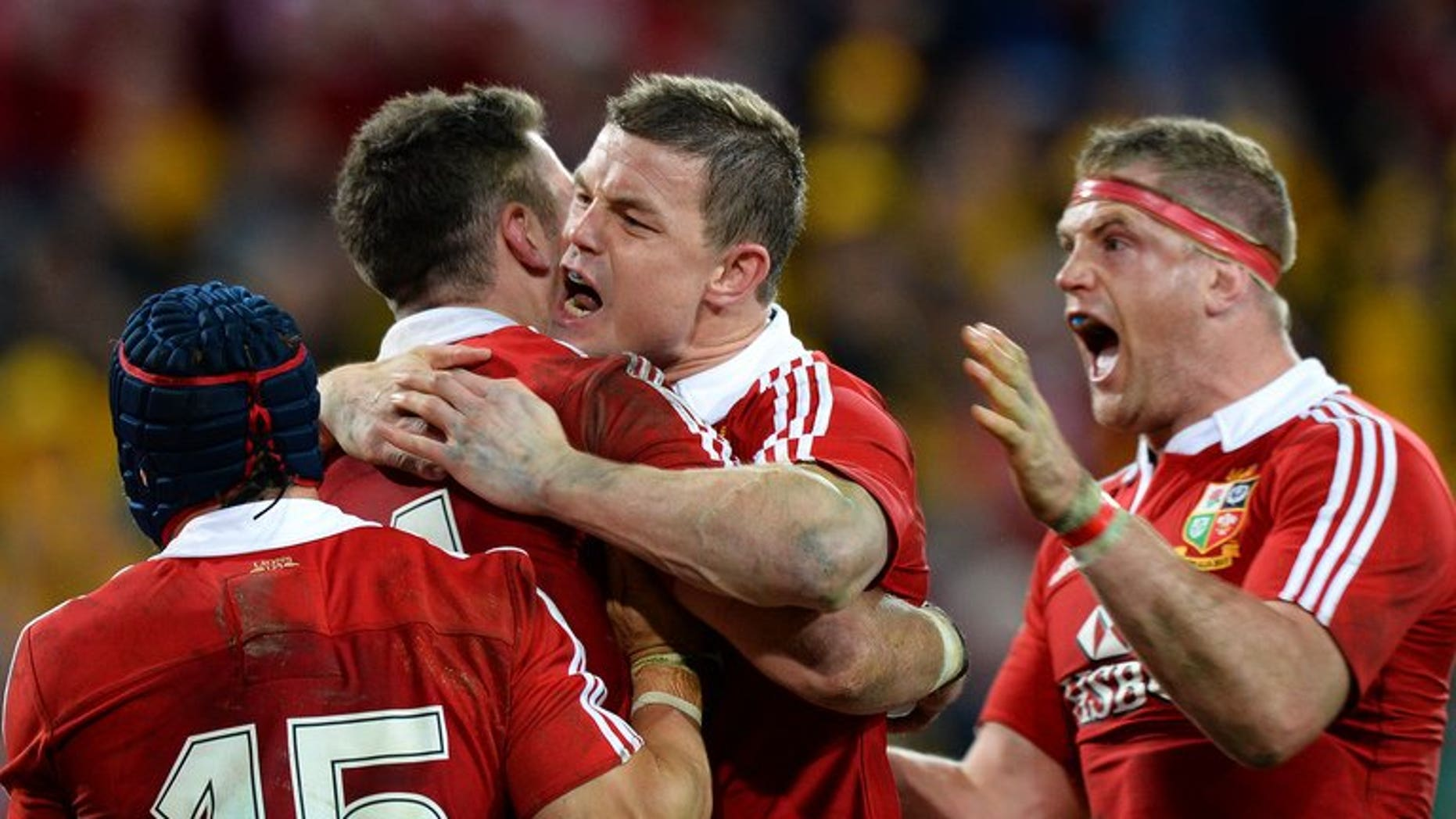 """The British and Irish Lions celebrate Alex Cuthbert's try against Australia on June 22, 2013. The thrilling 23-21 first Test win over Australia was """"larceny"""" and the rest of the series will be a similarly nerve-shredding affair, Britain's newspapers warned."""