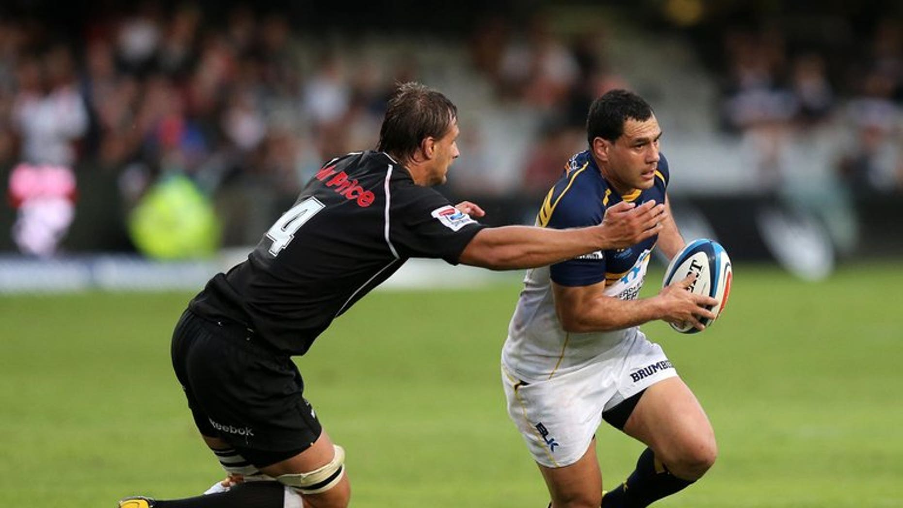 George Smith of the Brumbies (R) is tackled by Anton Bressler of the Sharks on March 16, 2013. The injury-hit Wallabies called up veteran flanker Smith among three reinforcements for the squad for next weekend's make-or-break Test with the British and Irish Lions.