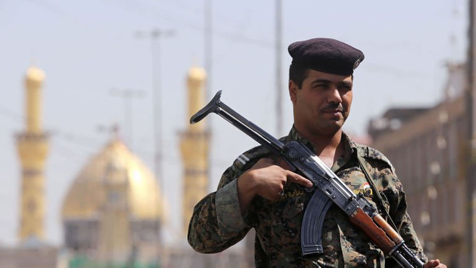 An Iraqi policeman stands guard outside the shrine of Imam Abbas as Shiite Muslims gather for the annual festival of Shaabaniya in the central city of Karbala, on June 23, 2013. Three car bombs, including a suicide attack, have killed at least four people in disputed territory in northern Iraq where analysts fear tensions could trigger a full-blown conflict.