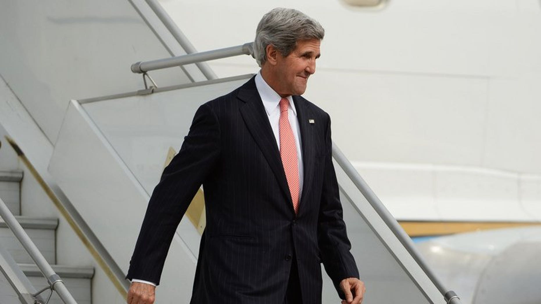 US Secretary of State John Kerry arrives at Palam Air Force Station in New Delhi, on June 23, 2013. Kerry has arrived on his first official visit to India, an AFP reporter said, as the US administration was rocked by news that a wanted former American intelligence operative had flown out of Hong Kong.