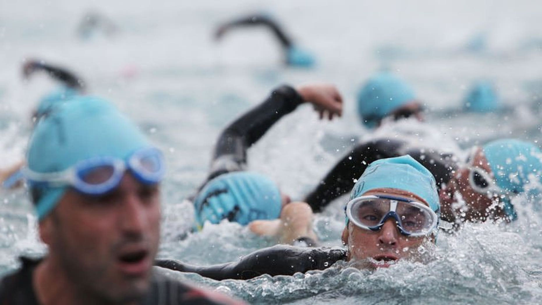 Triathletes swim during the Ironman race in Nice southeastern France on June 22, 2013. A 30-year-old Briton has died after crashing in the cycling section of the event on the French Riviera, emergency services said.