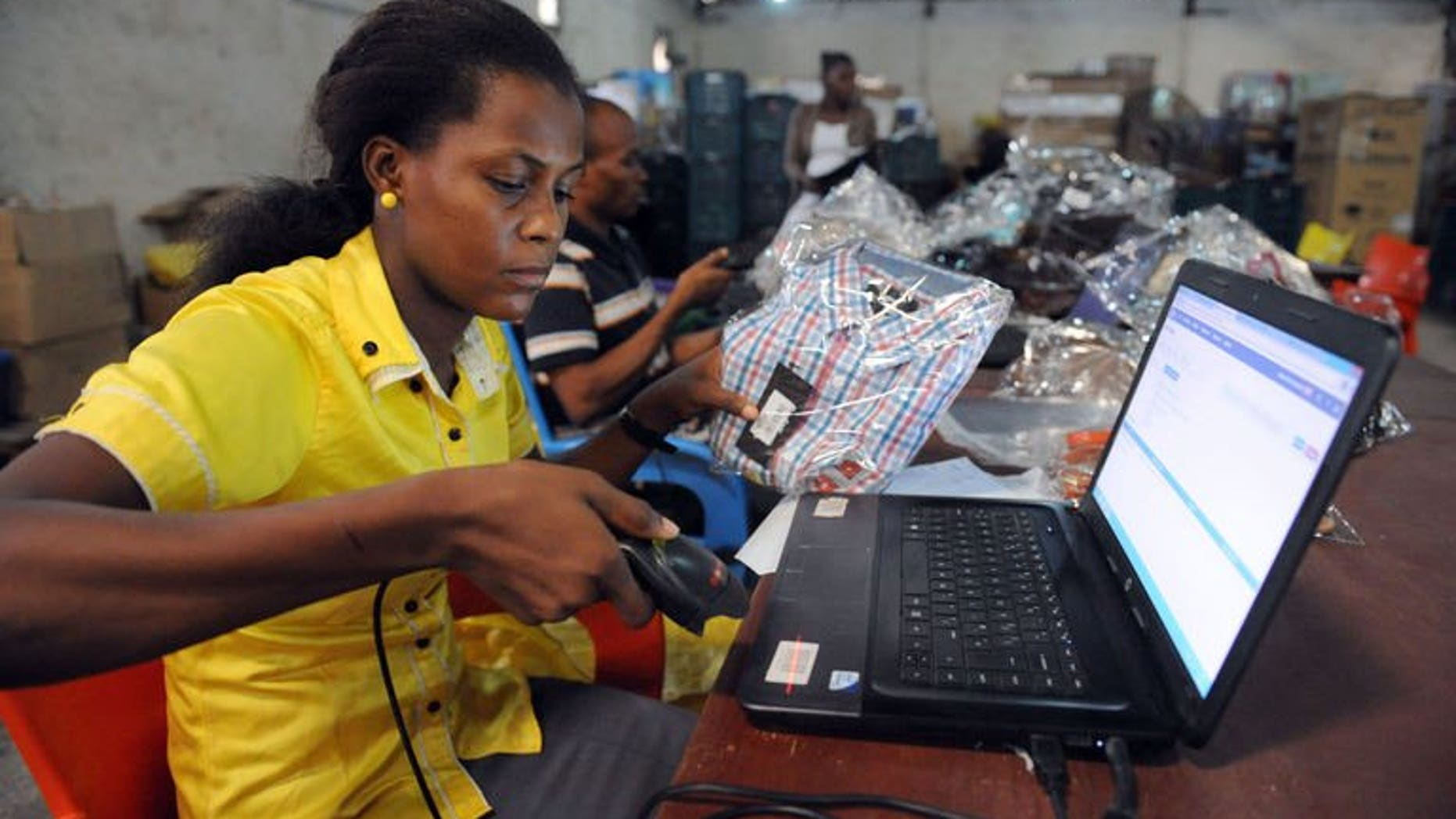 A worker at Internet company Jumia scans a product in Lagos, Nigeria on June 12, 2013. Nigeria, Africa's biggest market of 160 million people, has seen Internet access expand rapidly in recent years, opening opportunities for companies to exploit.