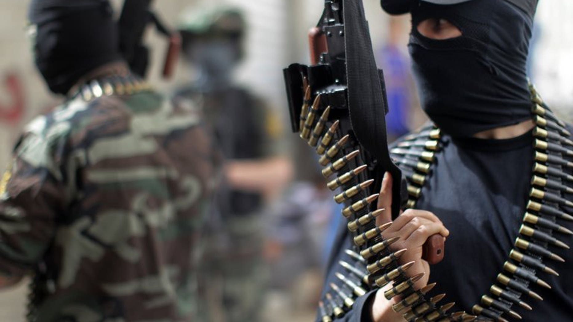 Palestinian militants from the Islamic Jihad group in Jabalia in the northern Gaza Strip on April 8, 2013. Islamic Jihad severed contacts with the Hamas rulers of Gaza Sunday after a commander in its military wing died of wounds sustained in a police shooting, a leader of the radical group told AFP.