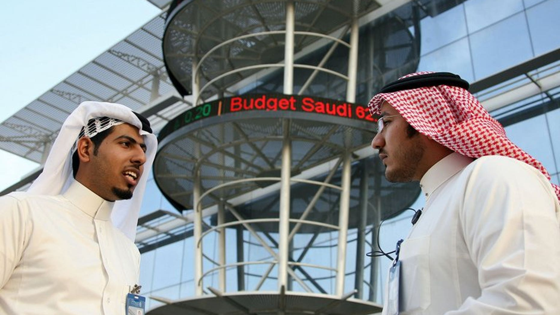 """Saudi men chat outside the Saudi Stock Exchange in Riyadh on December 5, 2009. Oil powerhouse Saudi Arabia is switching its weekend to Friday-Saturday to better serve its economy and """"international commitments,"""" the official SPA news agency reported on Sunday quoting a royal decree."""