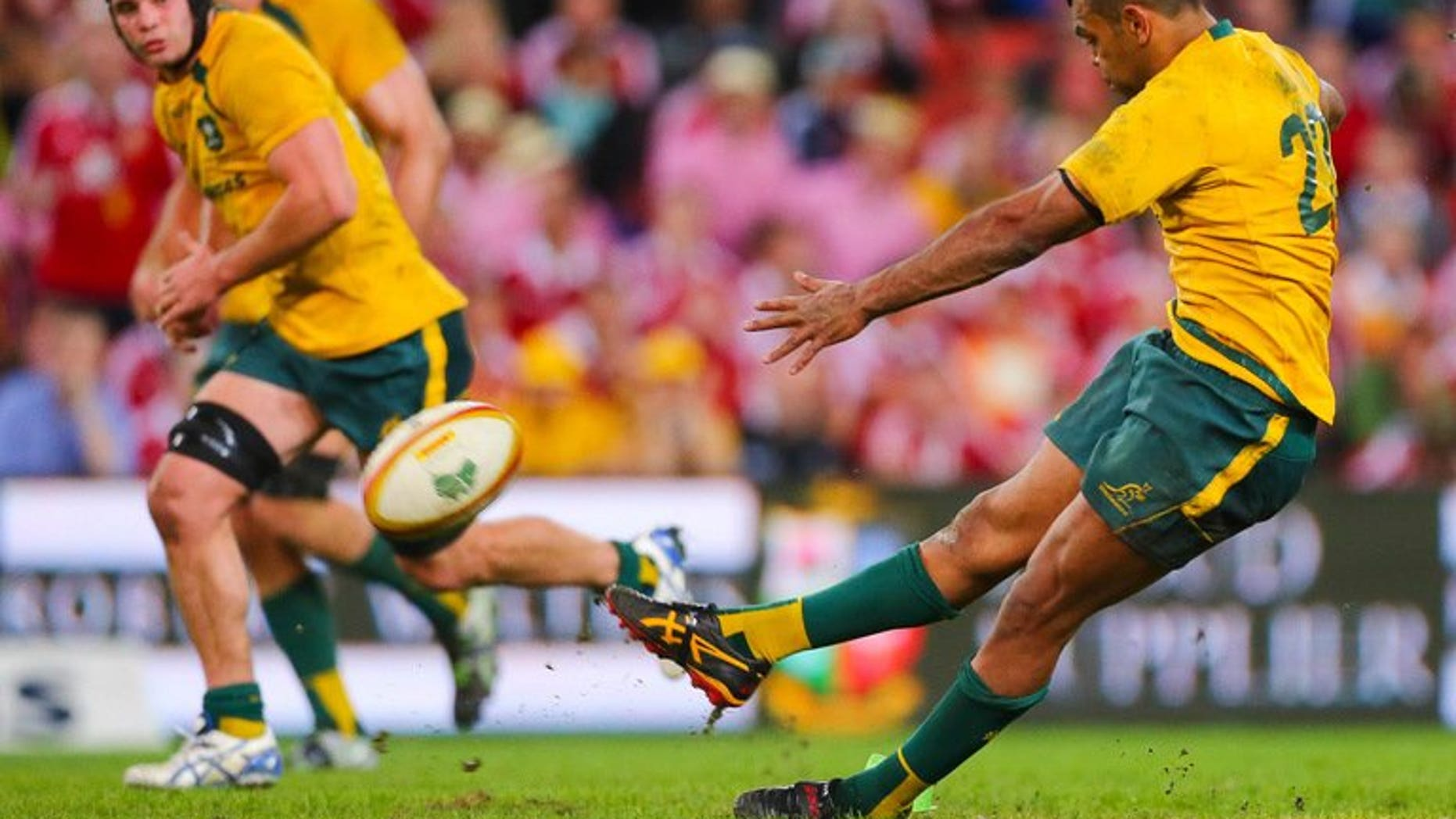 Australia's Kurtley Beale slips as he attempts a winning penalty against the British and Irish Lions on June 22, 2013. Lions coach Warren Gatland has taken a swipe at the battered Wallabies ahead of this week's potentially decisive Melbourne Test by hinting a lack of professionalism by Beale cost Australia victory in Brisbane.