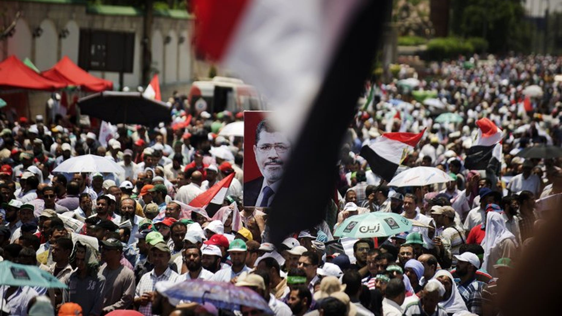 Egyptian Islamist groups led by the ruling Muslim Brotherhood mark the upcoming one-year anniversary since President Mohamed Morsi was elected, on June 21, 2013, in Cairo. Egypt's defence minister has warned that the army will intervene if violence breaks out in the country where opponents of Morsi are planning rallies against him.