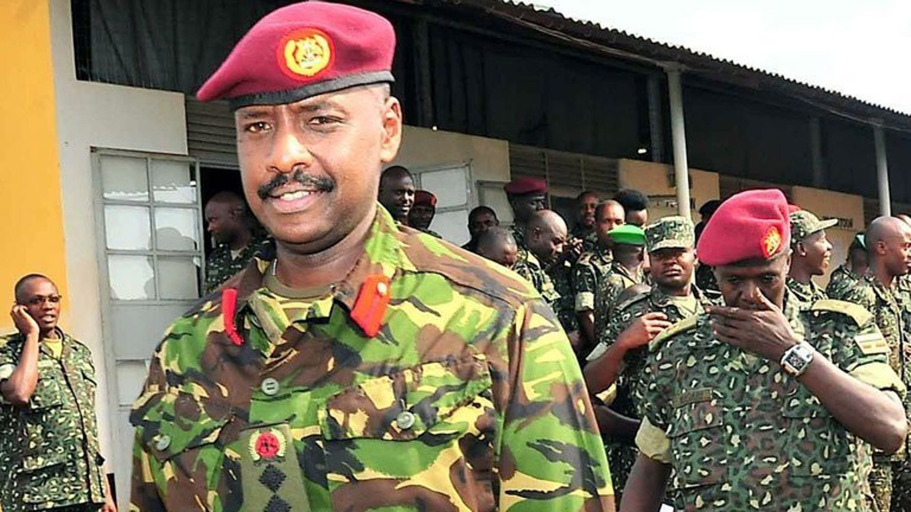 Brigadier Muhoozi Kainerugaba (L), son of Ugandan President Yoweri Museveni and commander of the Ugandan Special Forces Command, at the Sera Kasenyi training centre for Special Forces in Kampala on August 16, 2012. Kainerugaba has said he has no current plan to succeed his father, refuting weeks of opposition accusations he was preparing to take over power.