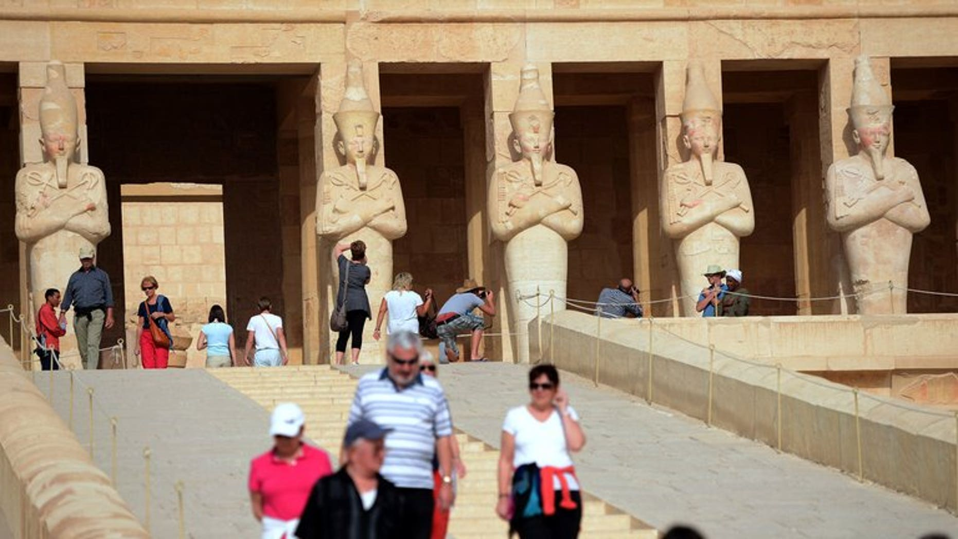 Tourists visit the Temple of Hatshepsut on February 27, 2013, in Egypt's ancient temple city of Luxor. Egypt's Tourism Minister Hesham Zazou was back at work on Monday after the newly appointed Islamist governor of Luxor quit following an outcry over his appointment to the post.
