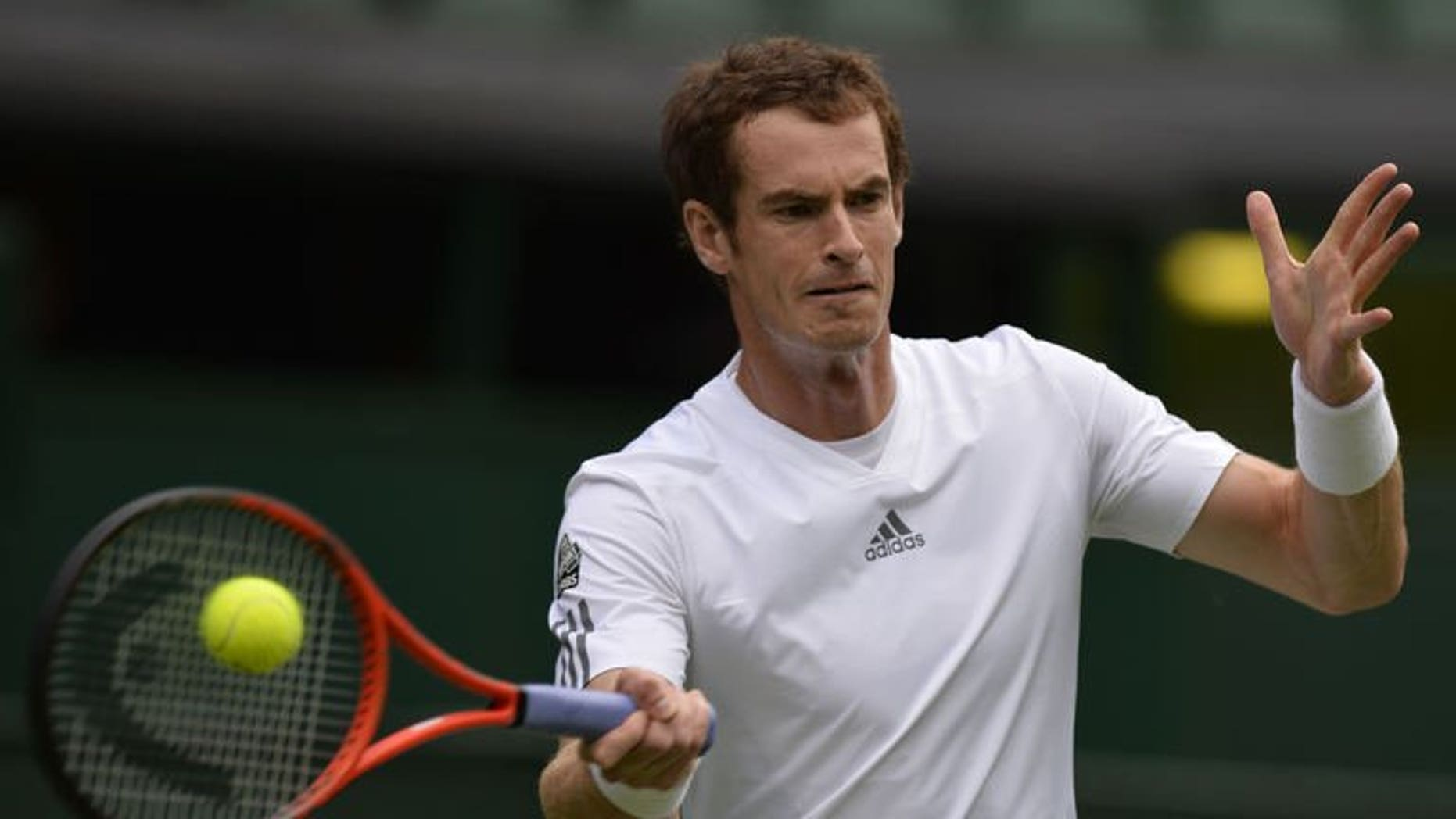 Britain's Andy Murray returns against Germany's Benjamin Becker during their men's first round match on day one of the 2013 Wimbledon Championships tennis tournament at the All England Club in Wimbledon, southwest London, on June 24, 2013. Murray made history as the world number two cruised into the Wimbledon second round with a 6-4, 6-3, 6-2 victory.