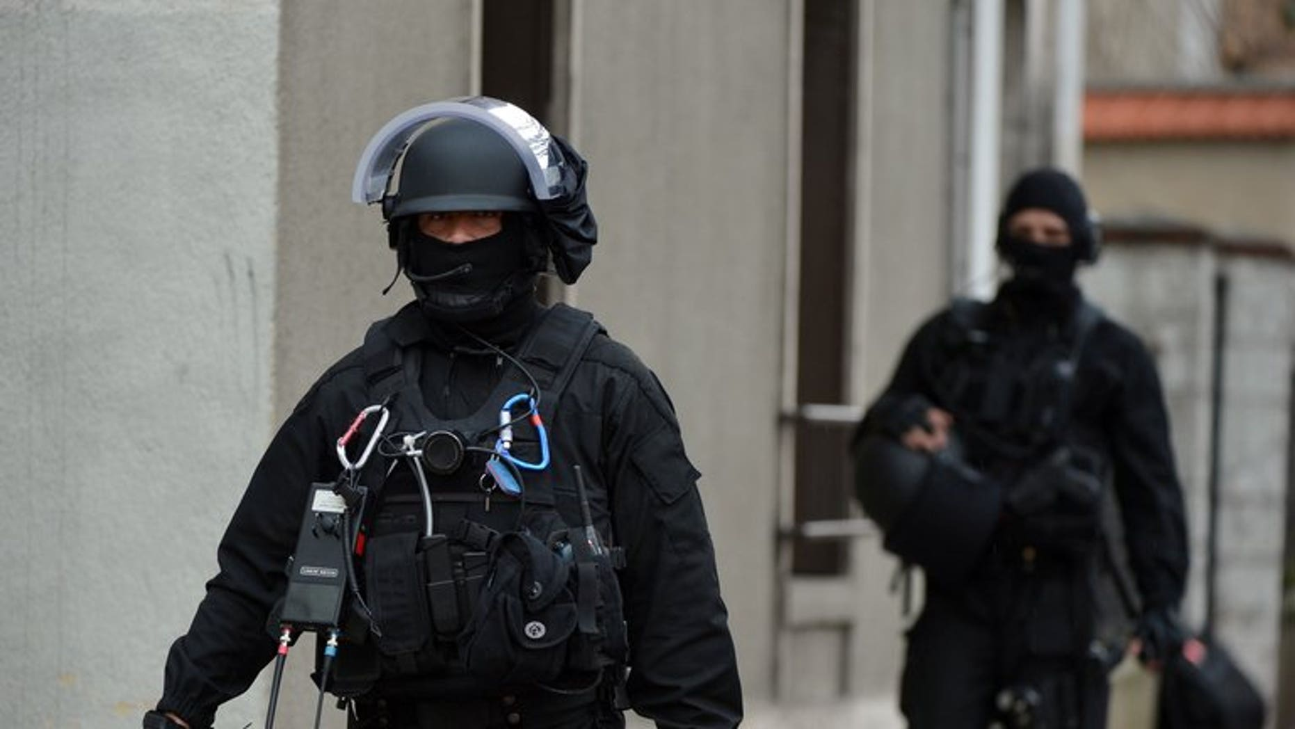 """Members of a special operations tactical unit of the French police are pictured on April 10, 2013 in a Paris suburb. Six people were arrested in the Paris region on Monday in coordinated raids on members of a suspected radical Islamist cell allegedly planning """"terrorist acts"""" on French soil, a source close to the investigation told AFP."""